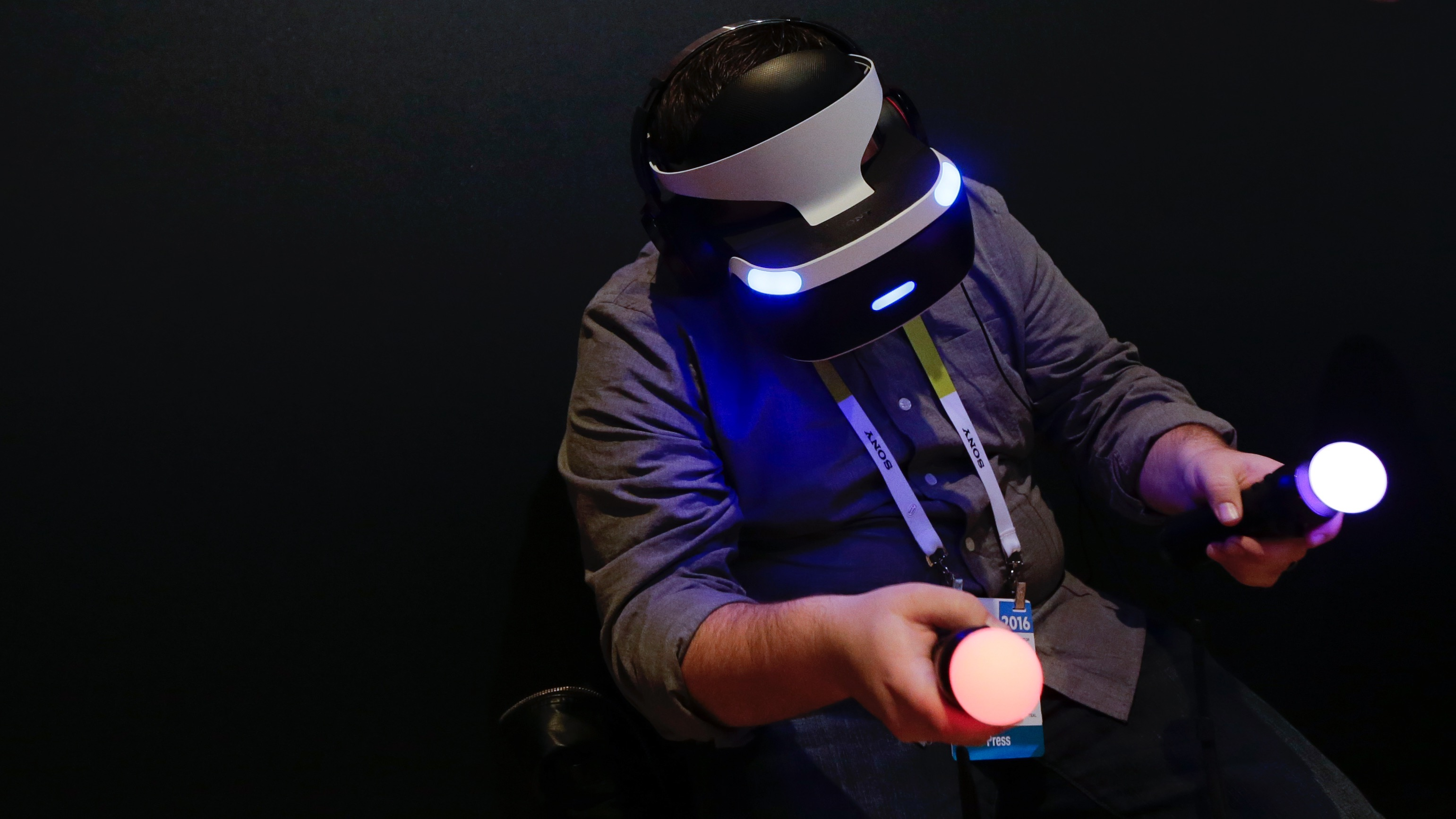 """William Mansell plays the video game, """"Until Dawn: Rush of Blood,"""" on a Playstation VR device during a news conference preview for CES International Tuesday, Jan. 5, 2016, in Las Vegas. (AP Photo/Gregory Bull)"""