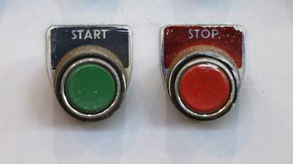 Start and stop buttons are seen in the turbine hall inside EDF Energy's Hinkley Point B Power Station.