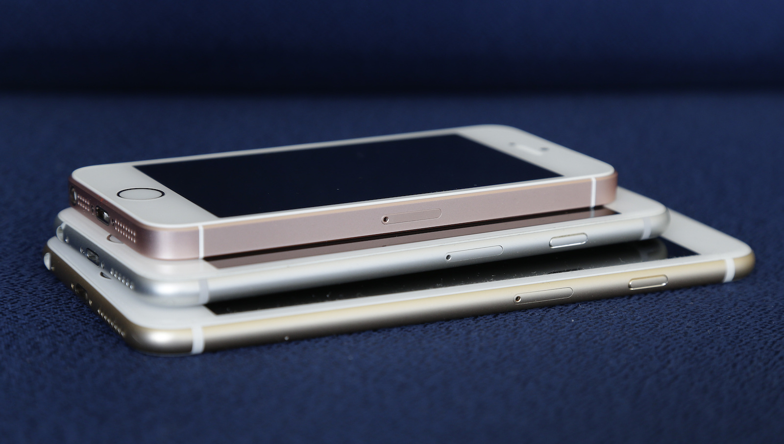 From bottom, the iPhone 6S Plus, 6S and SE lie stacked on one another in a comparison photograph, Thursday, March 24, 2016, in New York. Apple's new 4-inch iPhone SE is a good choice at a good price for many people. You get the same speeds, graphics capabilities and rear camera as the iPhone 6S, but for $250 less. (AP Photo/Julie Jacobson)