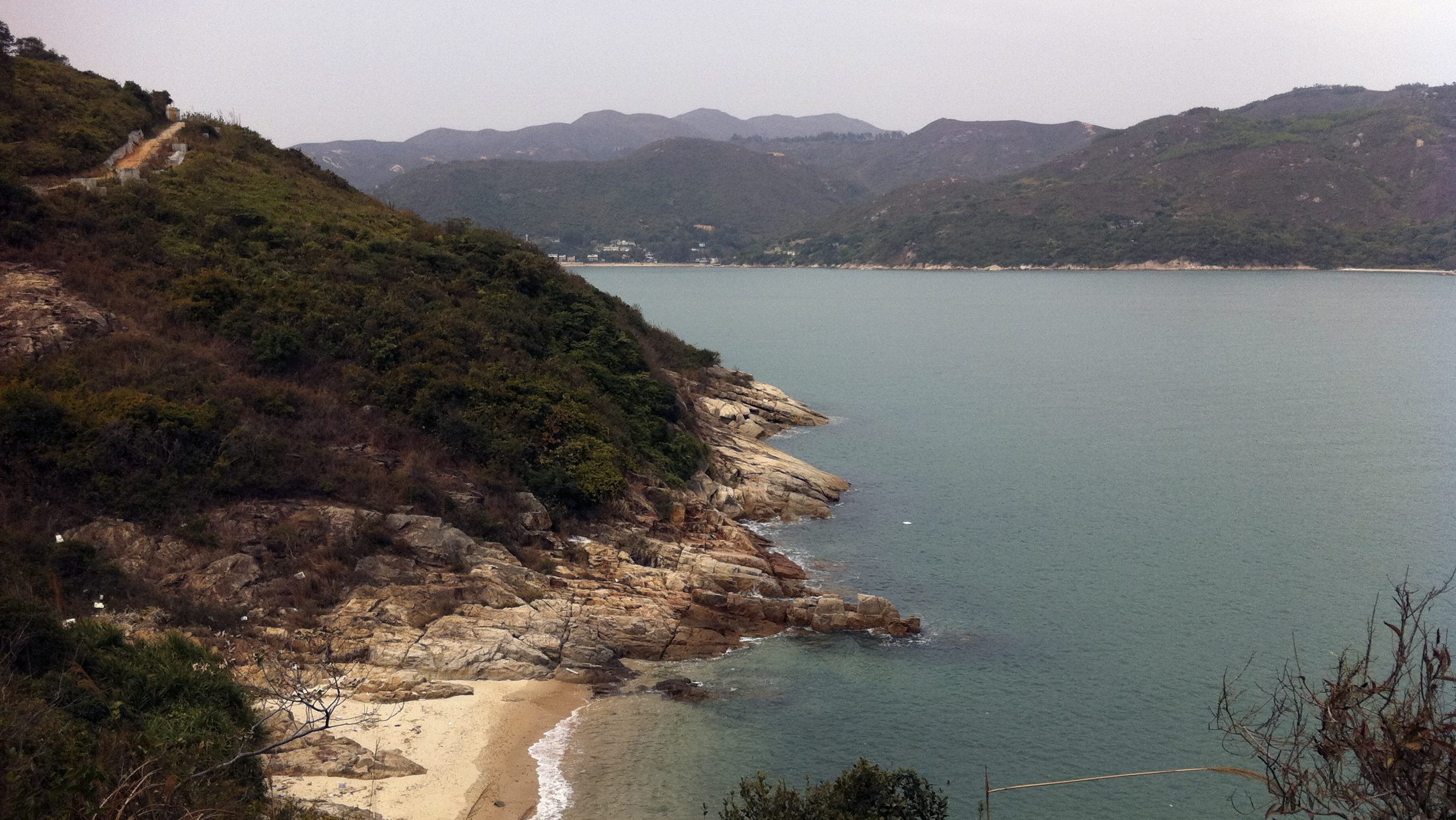 This March 2011 photo shows a view of Pui O Bay from a lookout point along the Lantau Trail on Lantau Island, about an hour by ferry from Hong Kong. Pui O makes a good starting point for further exploration of Lantau Island, with designated hiking trails, a large monastery, a fishing village, and a cable car to the Big Buddha available.    (AP Photo/Jessica Glazer)
