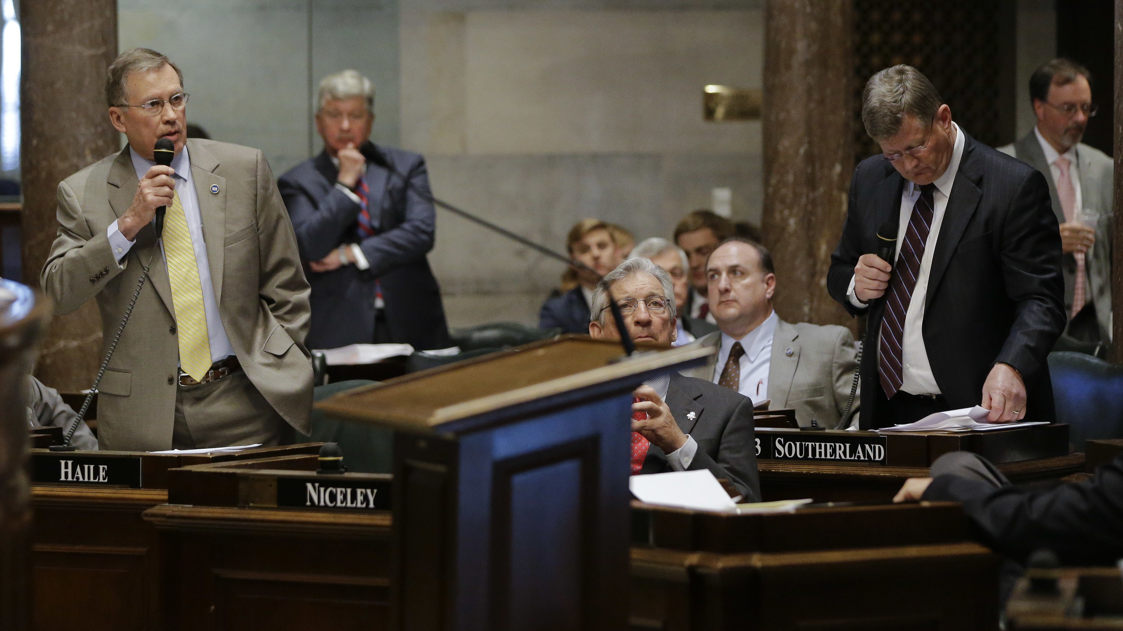 Sen. Ferrell Haile, R-Gallatin, left, speaks during debate on a bill by Sen. Steve Southerland, R-Morristown, front right, Monday, April 4, 2016, in Nashville, Tenn. Southerland's bill called for making the Holy Bible the official book of Tennessee. The Senate passed the bill over the objections of legislative leaders and the Republican governor. (AP Photo/Mark Humphrey)
