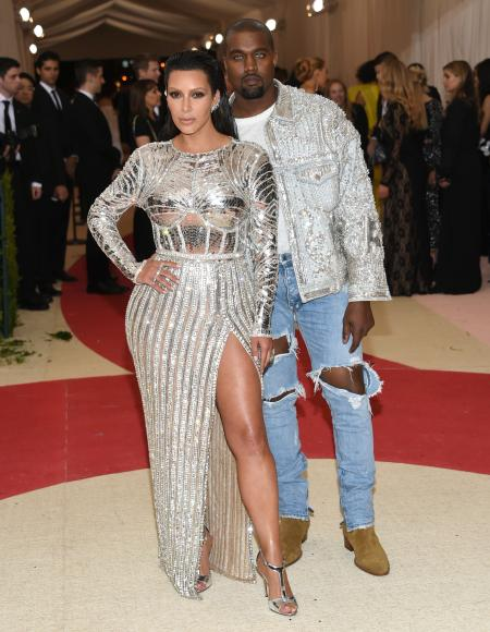 """Kim Kardashian, left, and Kanye West arrive at The Metropolitan Museum of Art Costume Institute Benefit Gala, celebrating the opening of """"Manus x Machina: Fashion in an Age of Technology"""" on Monday, May 2, 2016, in New York. (Photo by Evan Agostini/Invision/AP)"""