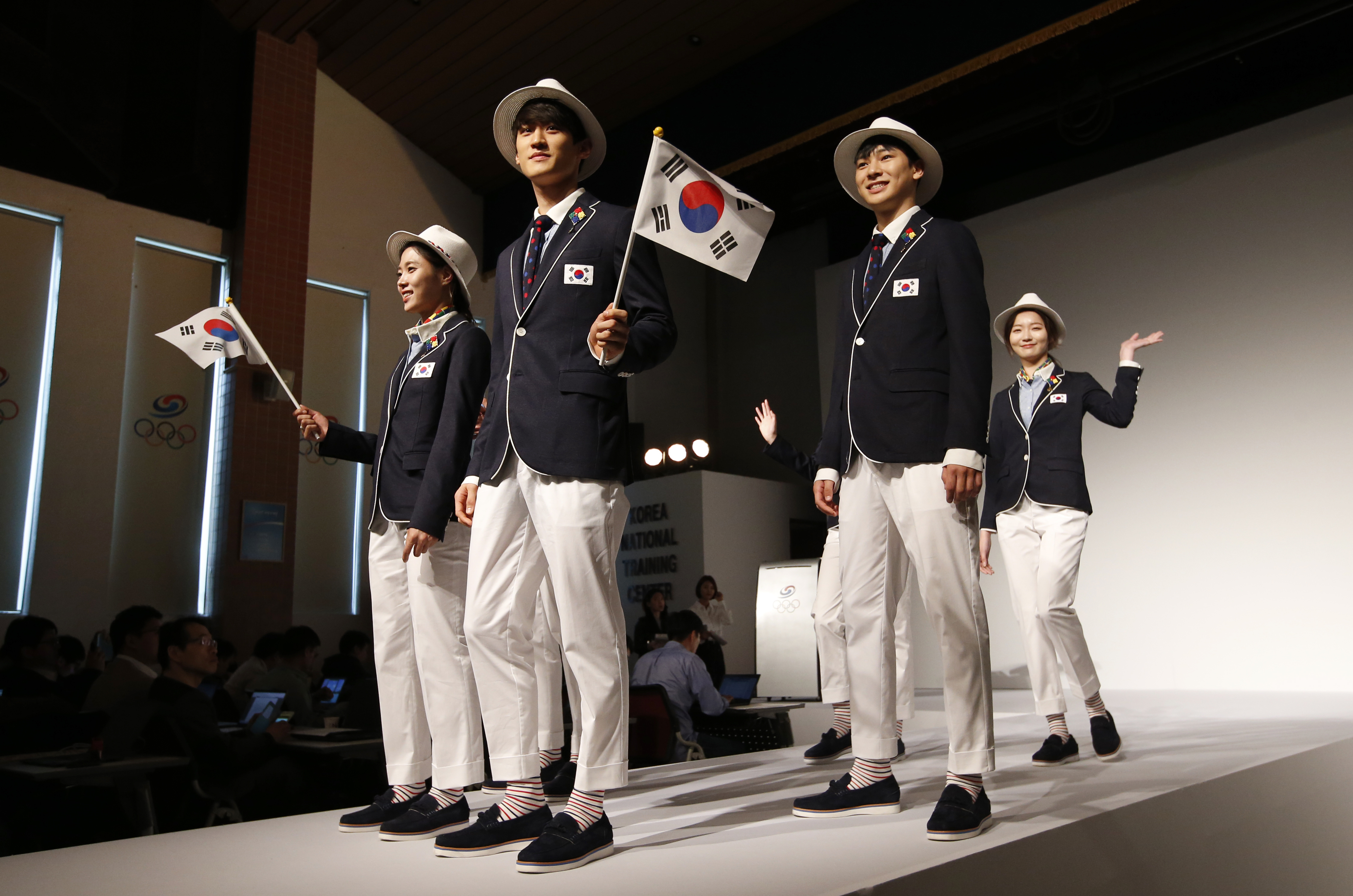 South Korean Olympic athletes and models present the South Korean Olympic team uniforms for the opening and closing ceremonies of the 2016 Rio de Janeiro Olympic Games at Korean National Training Center in Seoul, South Korea, Wednesday, April 27, 2016. South Korea's Olympic committee on Wednesday unveiled long-sleeved shirts and pants it says will help protect the country's Olympic athletes from the mosquito-borne Zika virus at this year's games in Rio de Janeiro. (AP Photo/Lee Jin-man)
