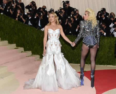 """Kate Hudson, left, and Lady Gaga arrive at The Metropolitan Museum of Art Costume Institute Benefit Gala, celebrating the opening of """"Manus x Machina: Fashion in an Age of Technology"""" on Monday, May 2, 2016, in New York. (Photo by Evan Agostini/Invision/AP)"""