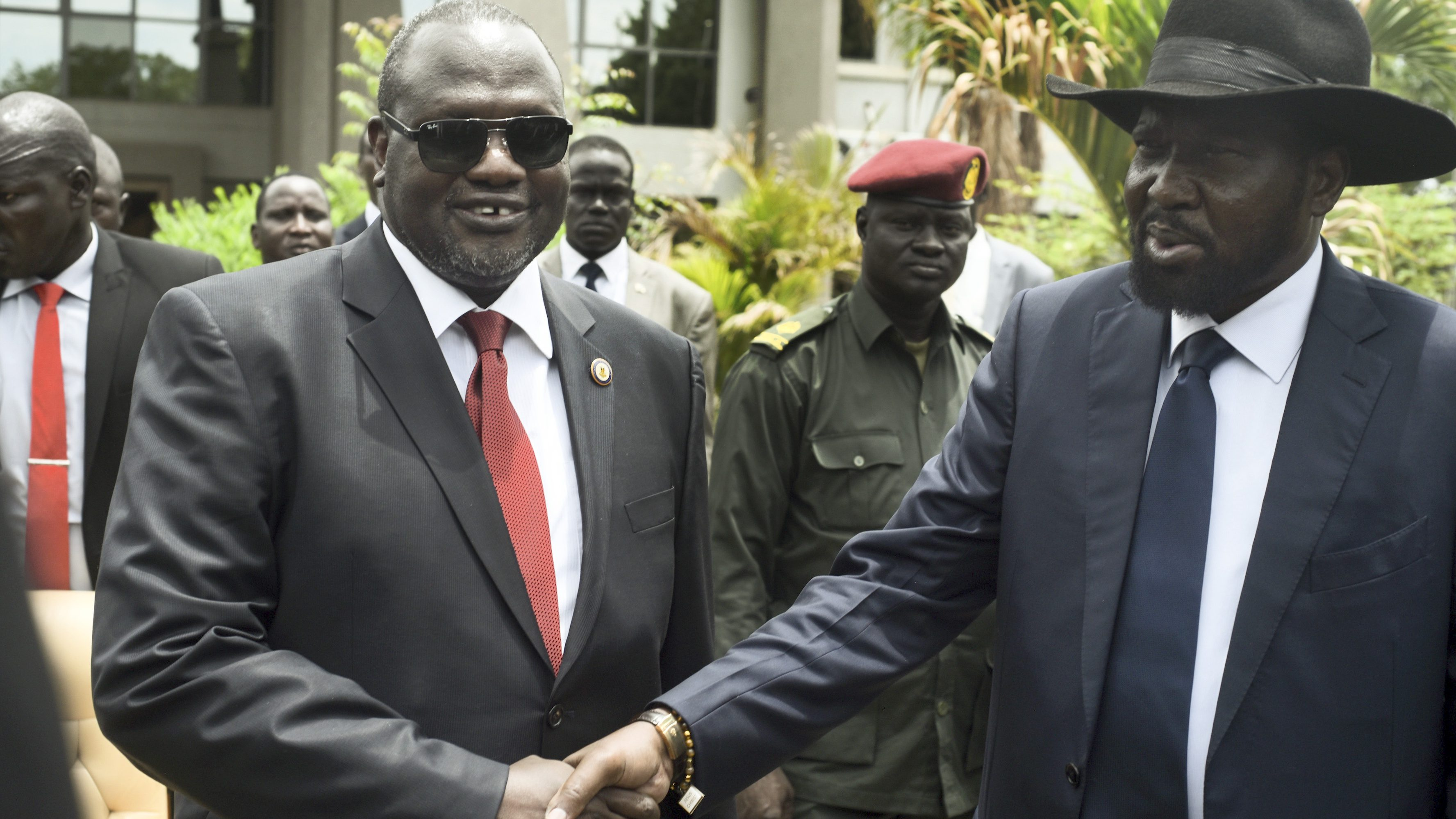 South Sudan's first vice president Riek Machar, left, and President Salva Kiir, right, shake hands following the first meeting of a new transitional coalition government, in the capital Juba, South Sudan, Apr. 29.