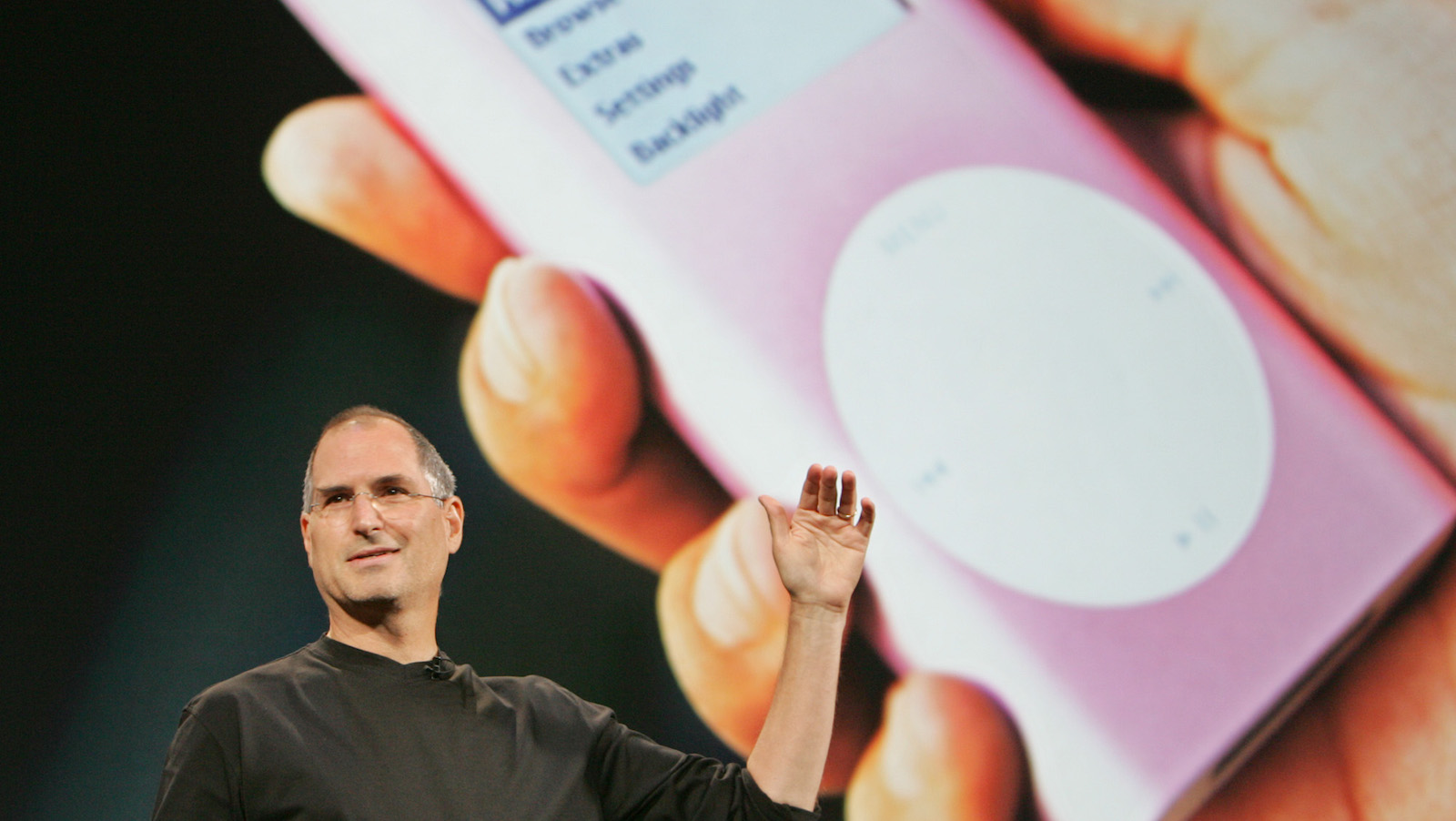 FILE - In this Aug. 4, 2005 file photo, Apple CEO Steve Jobs speaks during a launch event for Apple's music download service, iTunes, in Tokyo. A billion-dollar class-action lawsuit over Apple's iPod music players heads to trial in a California federal court Tuesday, Dec. 2, 2014, in an antitrust case where the legal wrangling has lasted far longer than the technology that sparked the complaint. (AP Photo/Shizuo Kambayashi, File)