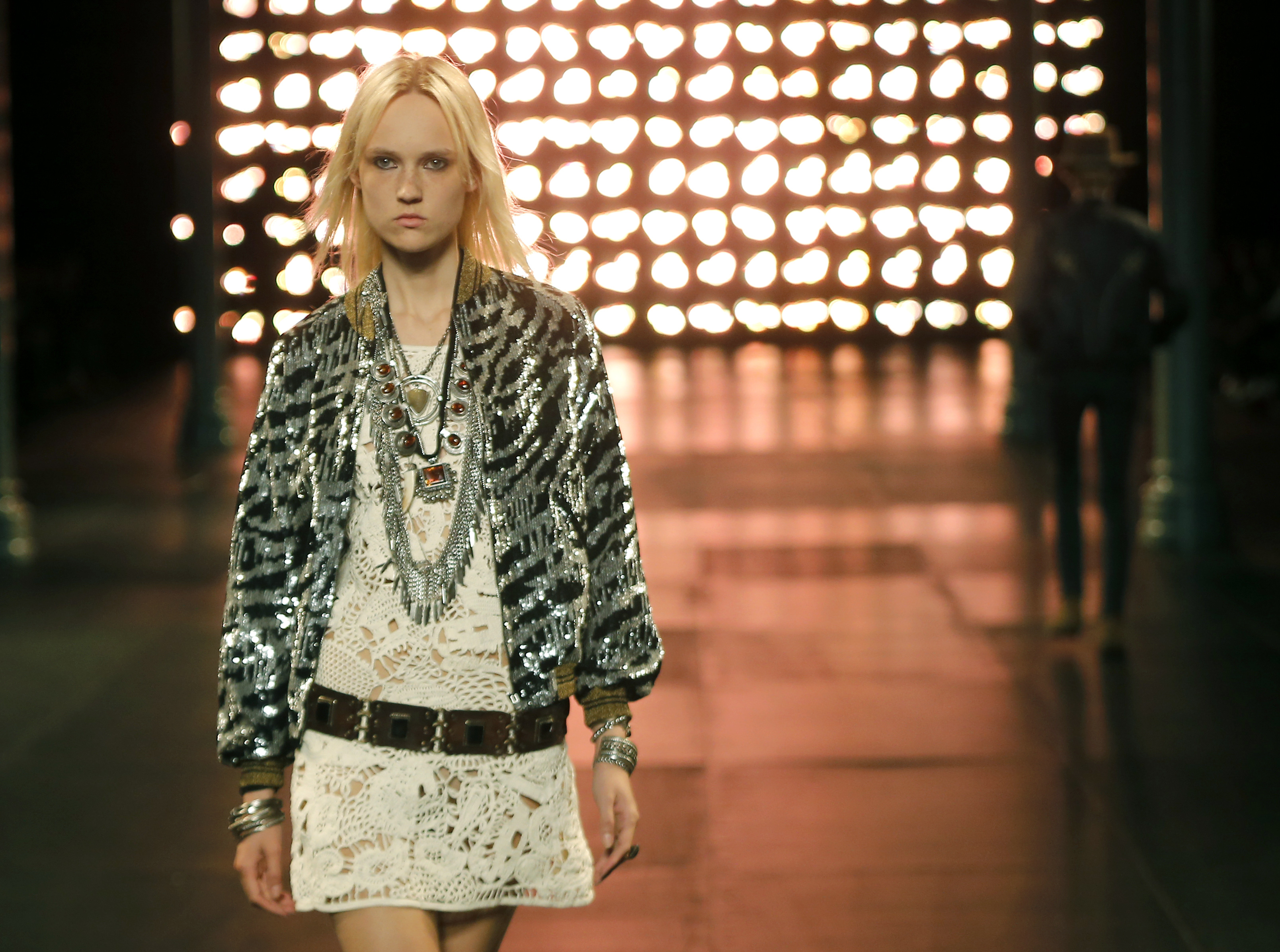 A model wears a creation by French-born designer Hedi Slimane for Saint Laurent men's Spring-Summer 2015 fashion collection, presented in Paris, Sunday, June 29, 2014.