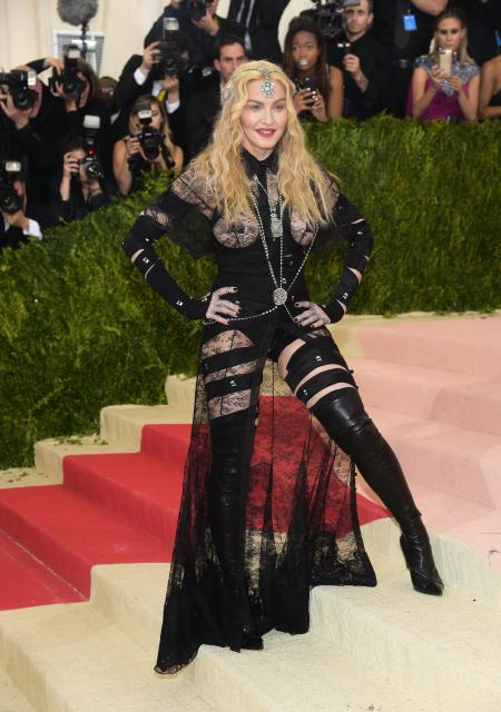 """Madonna arrives at The Metropolitan Museum of Art Costume Institute Benefit Gala, celebrating the opening of """"Manus x Machina: Fashion in an Age of Technology"""" on Monday, May 2, 2016, in New York. (Photo by Charles Sykes/Invision/AP)"""