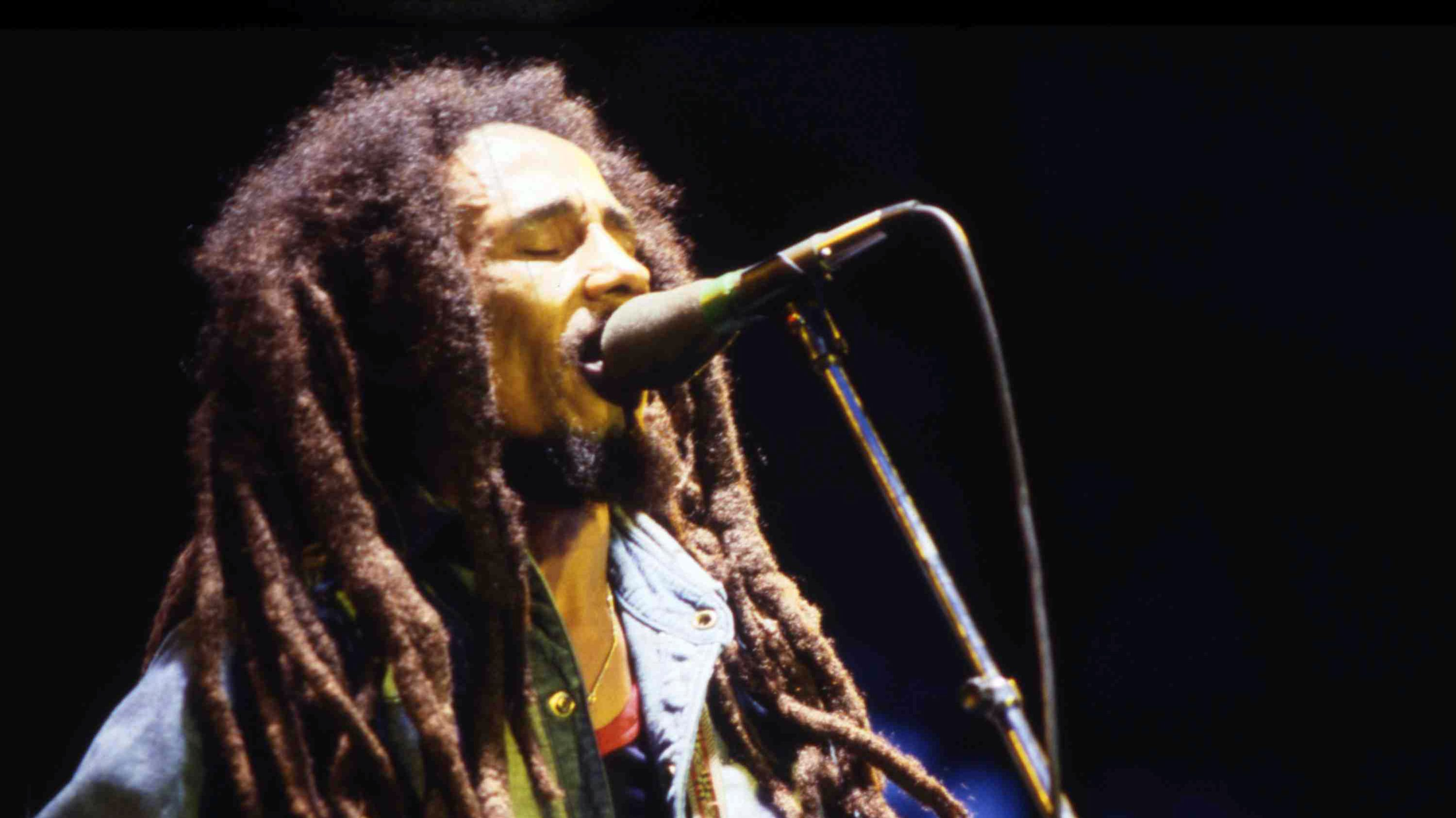 Jamaican Reggae singer Bob Marley performs on stage during a concert in Bourget, Paris, on July 3, 1980. (