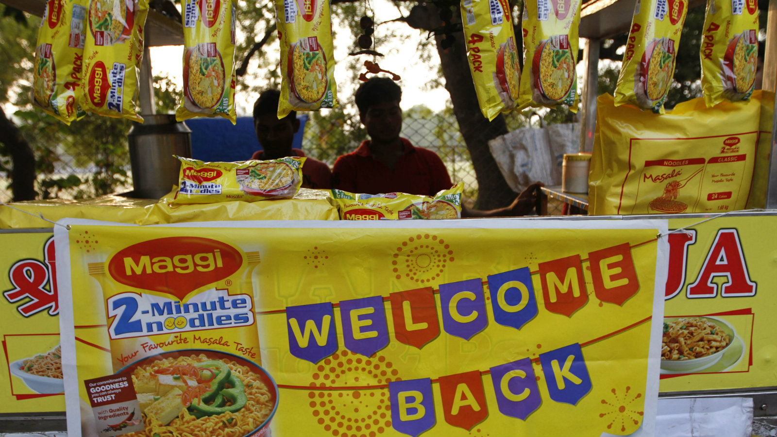 Packets of Maggi noodles hang on display at a roadside stall in Ahmadabad, India, Monday, Nov. 9, 2015. Maggi noodles are back on shelves in India five months after the popular snack was found to contain lead above permissible limits.
