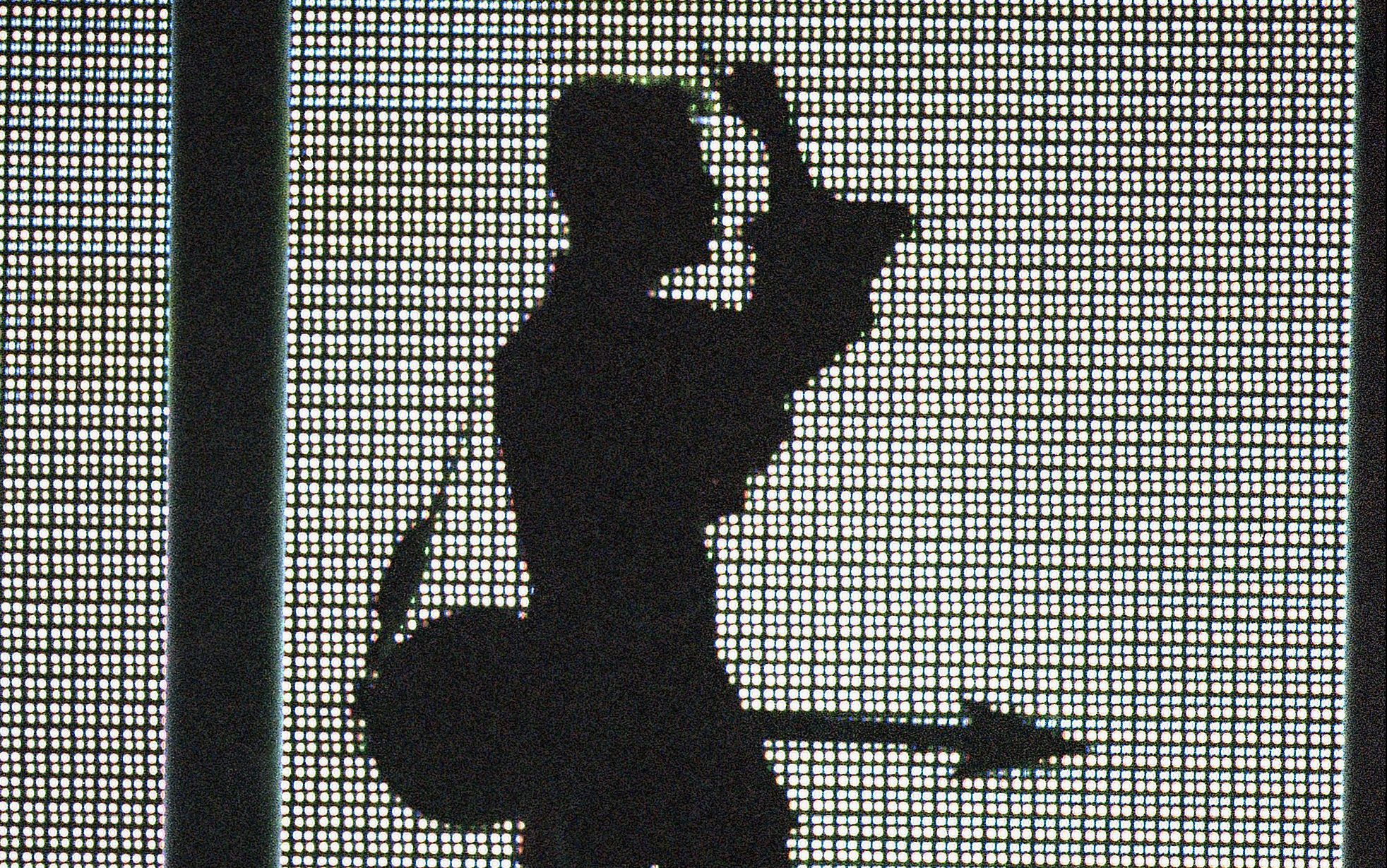 The artist formally known as Prince, silhouetted with his guitar in front of a large television screen, performs ?Holly River? at the ?4th annual VH1 Honors? on Thursday, April 10, 1997 in Universal City, Calif. (AP Photo/Mark J. Terrill)