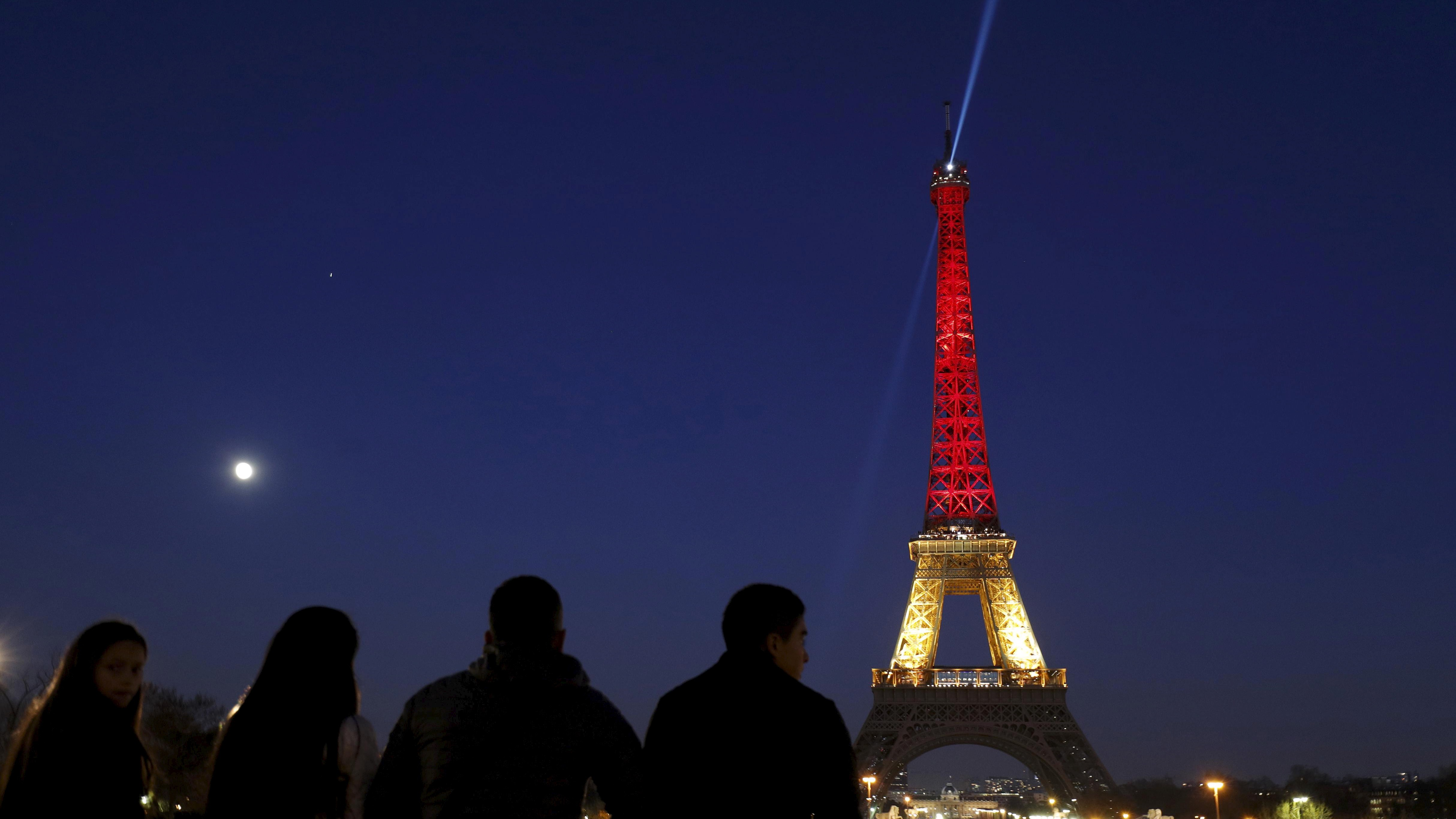 The Eiffel Tower is seen with the black, yellow and red colours of the Belgian flag in tribute to the victims of today's Brussels bomb attacks, in Paris, France, March 22, 2016.