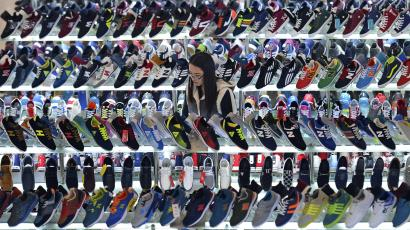 A customer shops for shoes at a mall in Hefei