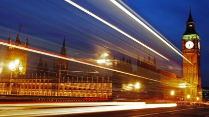 Light trails made by a passing bus illuminate the night sky in front of Britain's Houses of Parliament in London