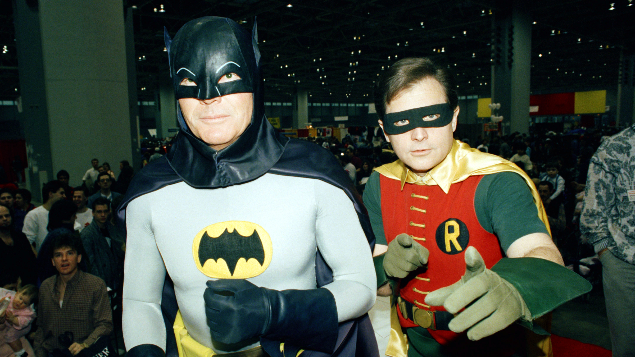 """Actors Adam West, left, and Burt Ward dresses as their characters (Zappp!) """"Batman"""" and (Powww!) """"Robin,"""" pause during an appearance January 27, 1989 at the """"World of Wheels"""" custom car show, Sunday in Chicago. The two, who are enjoying a revival of interest in the old """"Batman"""" TV show, are featured in several upcoming movies."""