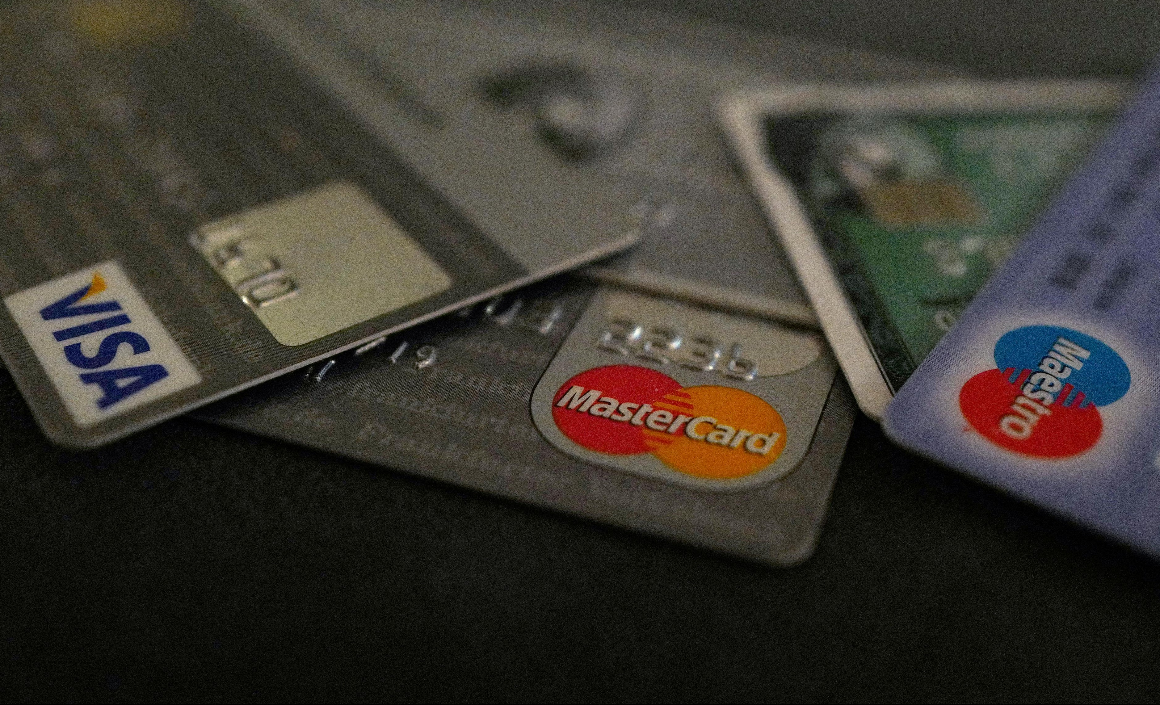 Bank debit and credit cards are photographed in this illustration picture at an office in Frankfurt
