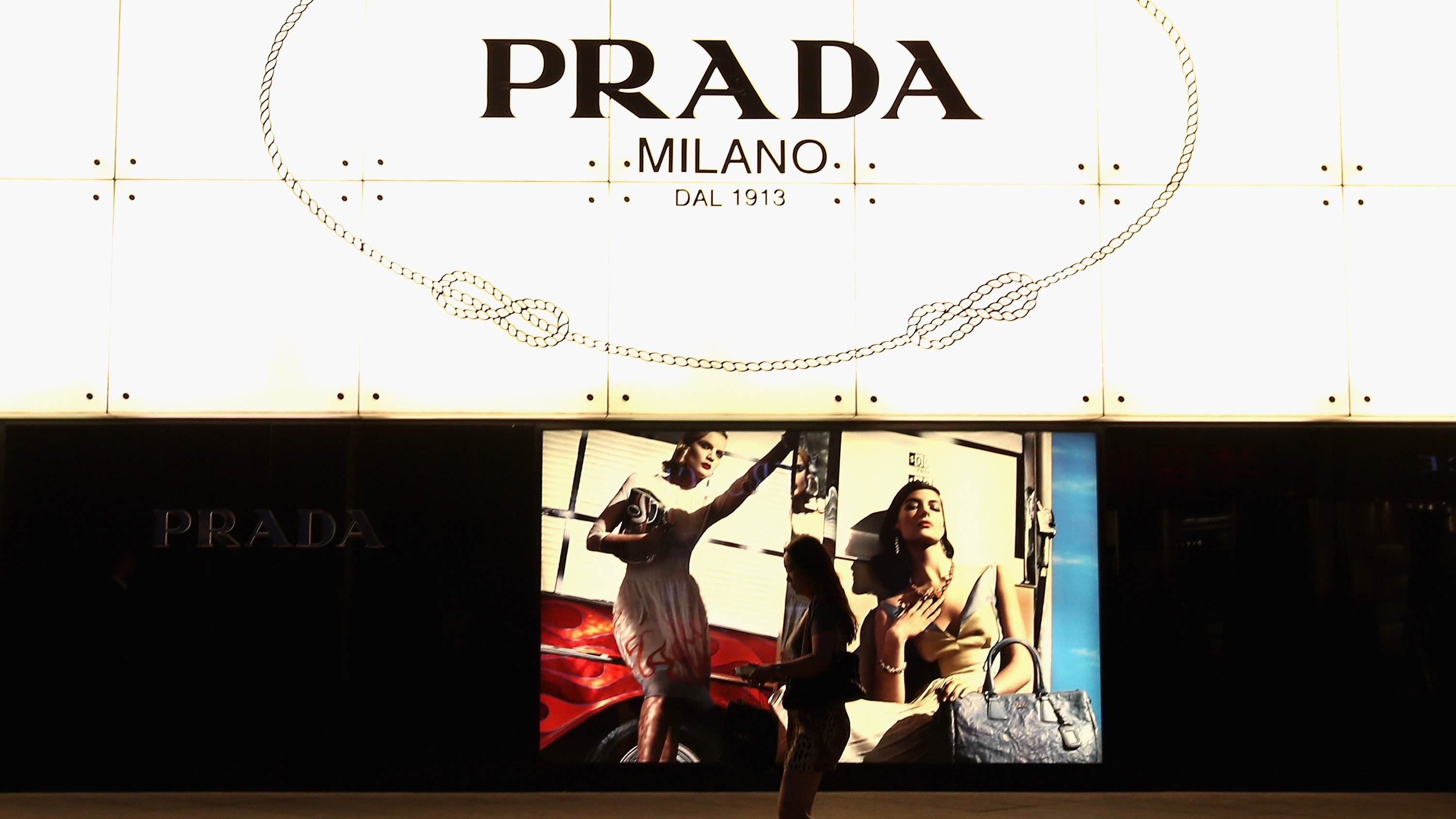 A Chinese woman walks past the Prada store on June 8, 2012 in Beijing, China.