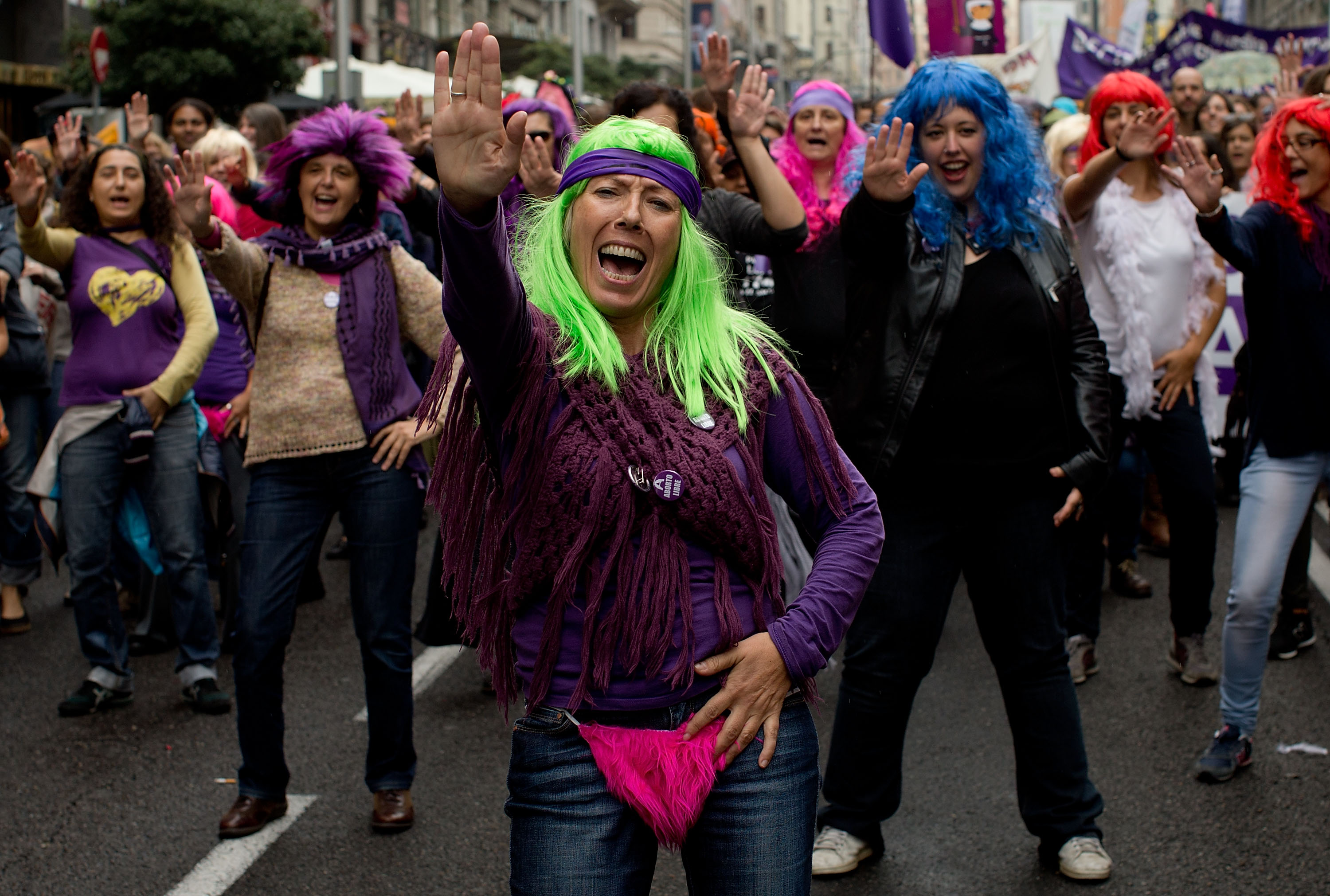 Women dance during a demonstration supporting reproductive rights for women on September 28, 2014 in Madrid, Spain.