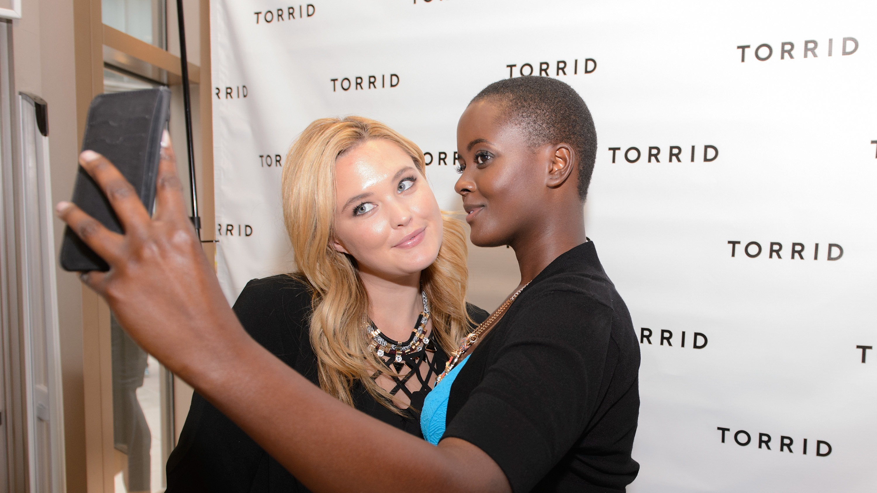 Georgina Burke and Philomena Kwao attend the grand opening of the TORRID flagship store on Chicago's State Street on April 8, 2015 in Chicago, Illinois.