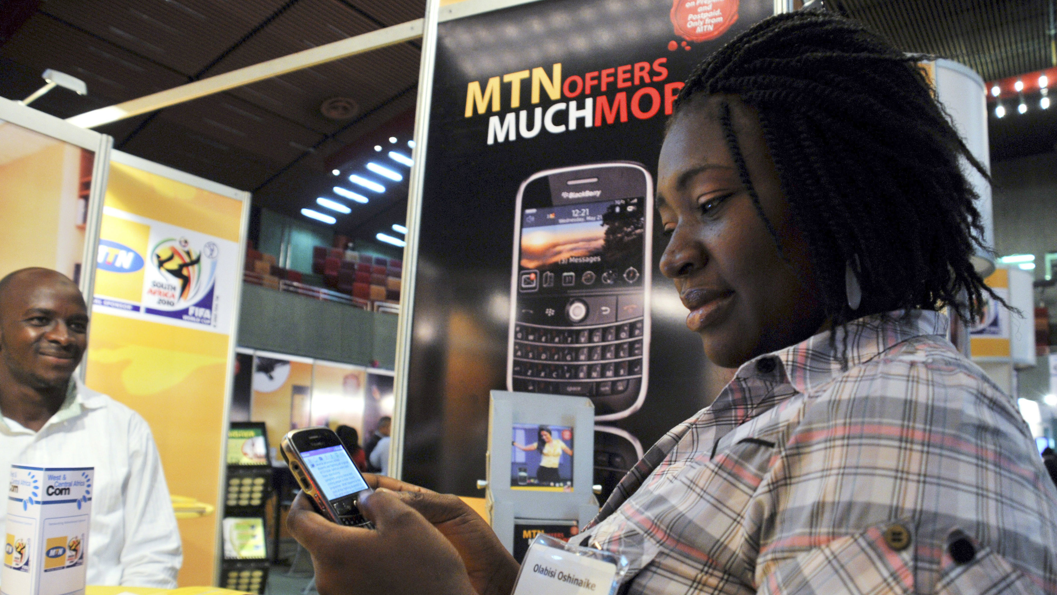 A delegate checks a blackberry handset at an exhibition stand during the West & Central Africa Com conference in Nigeria's capital Abuja, June 18, 2009.