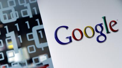 FILE - In this March 23, 2010, file photo, the Google logo is seen at the Google headquarters in Brussels. Google is disclosing how much of the traffic to its search engine and other services is being protected from hackers as part of its push to encrypt all online activity. Encryption shields 77 percent of the requests sent from around the world to Google's data centers, up from 52 percent at the end of 2013, according to company statistics released Tuesday, March 15, 2016. (AP Photo/Virginia Mayo, File)
