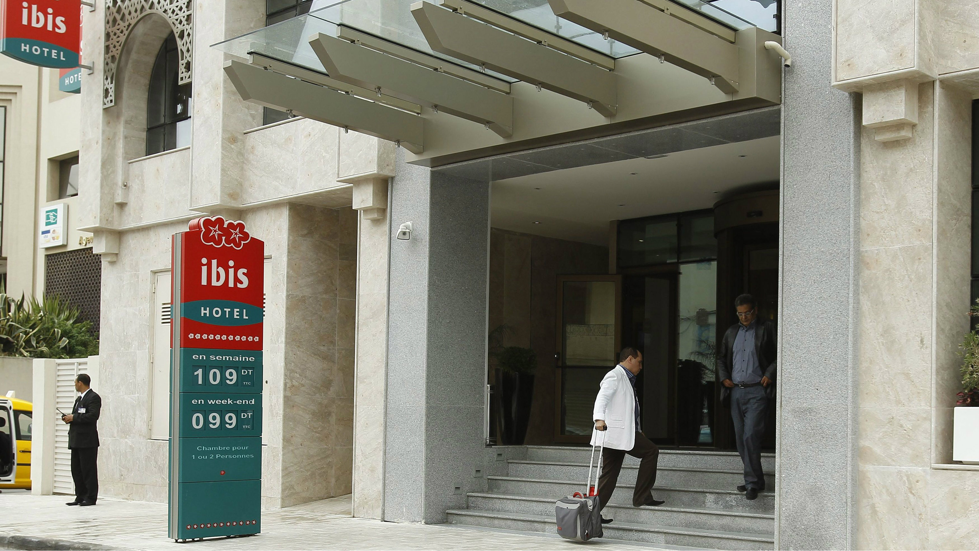 A guest enters the lobby of the Ibis hotel, in Mohamed V avenue, in Tunisia April 3, 2012
