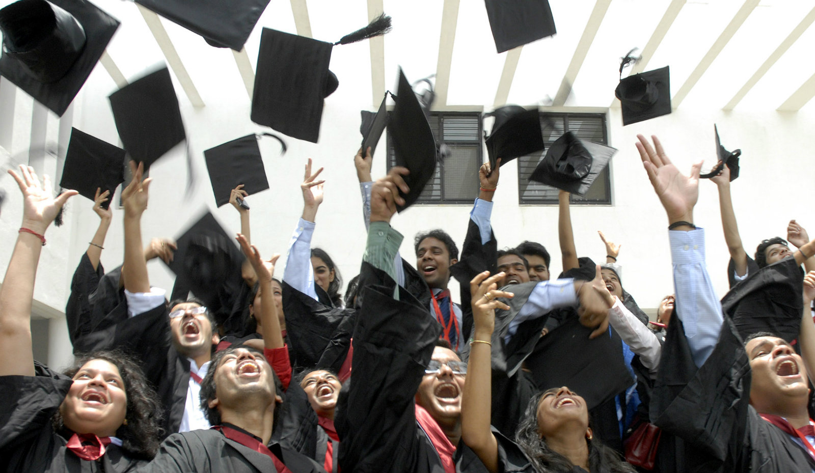 Students of the graduating class of the National Academy of Legal Studies and Research (NALSAR), University of Law, throw their caps in the air as they participate in their farewell cheer in the southern Indian city of Hyderabad July 21, 2007.