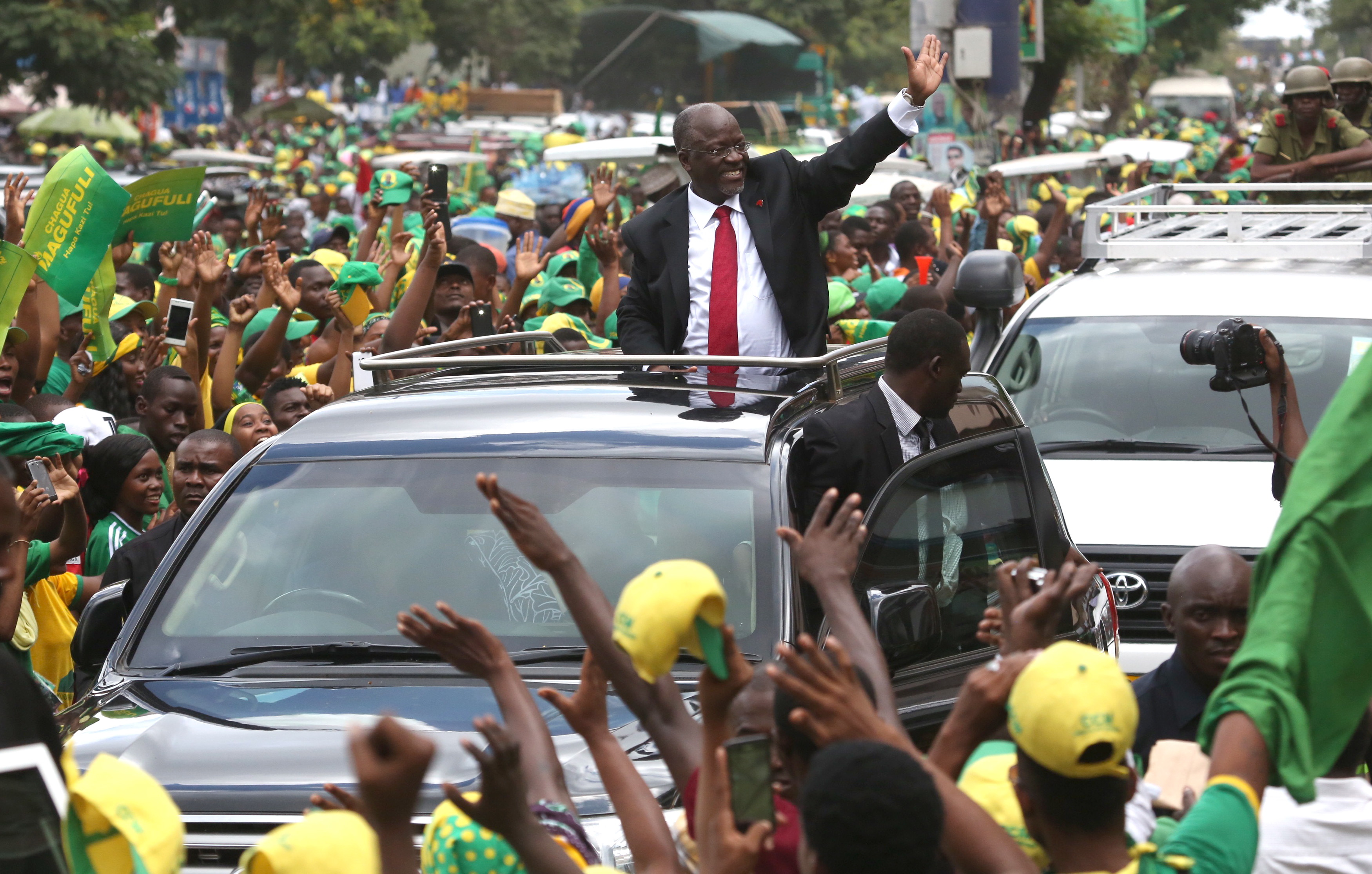 Tanzania's President elect John Pombe Magufuli (C) salutes members of the ruling Chama Cha Mapinduzi Party (CCM) as he arrives at the party's sub-head office on Lumumba road in Dar es Salaam, October 30, 2015. Tanzania's ruling party candidate, John Magufuli, was declared winner on Thursday of a presidential election, after the national electoral body dismissed opposition complaints about the process and a demand for a recount. The election has been the most hotly contested race in the more than half a century of rule by the Chama Cha Mapinduzi Party, which fielded Magufuli, 56, a minister for public works.