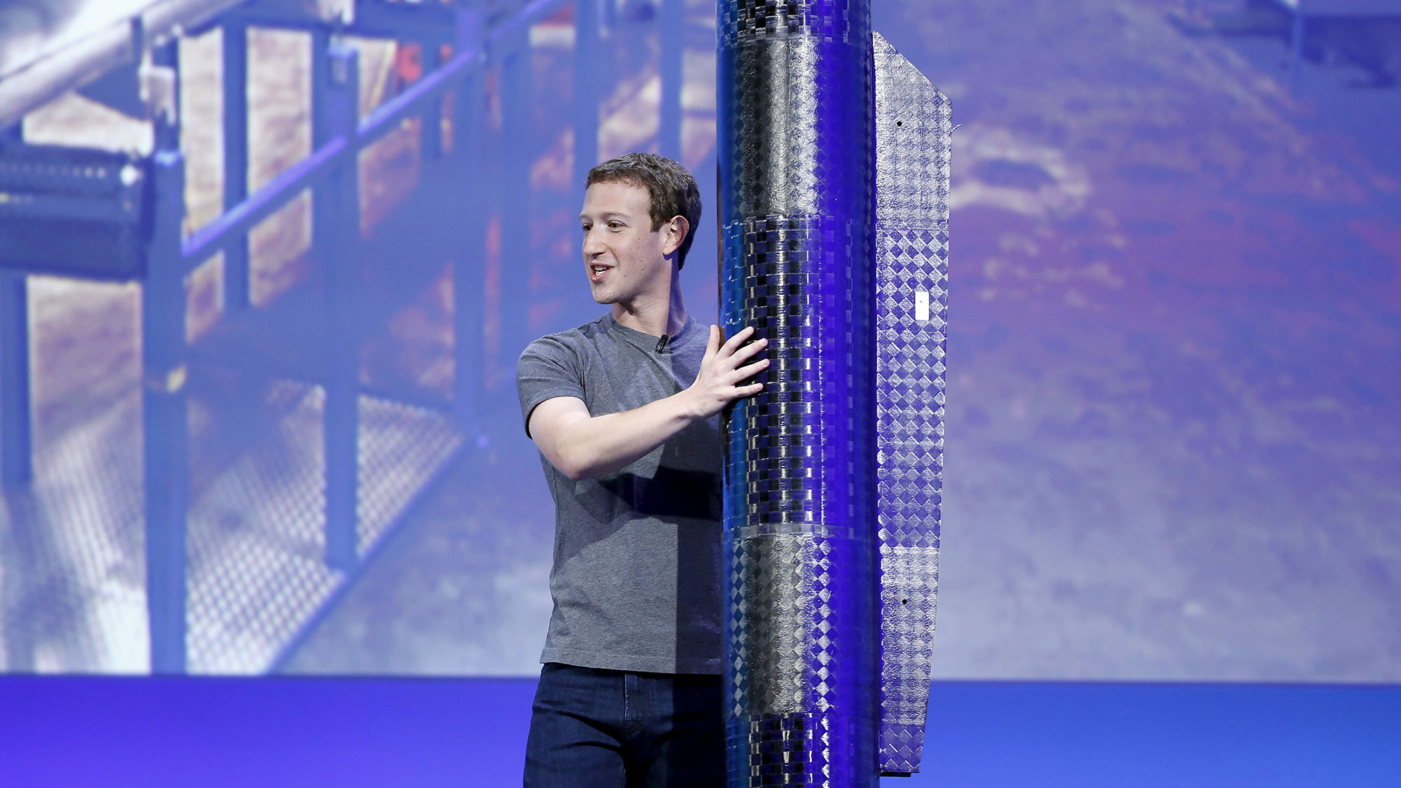 Facebook CEO Mark Zuckerberg holds a propeller pod of the solar-powered Aquila drone on stage during a keynote at the Facebook F8 conference in San Francisco, California April 12, 2016. REUTERS/Stephen Lam