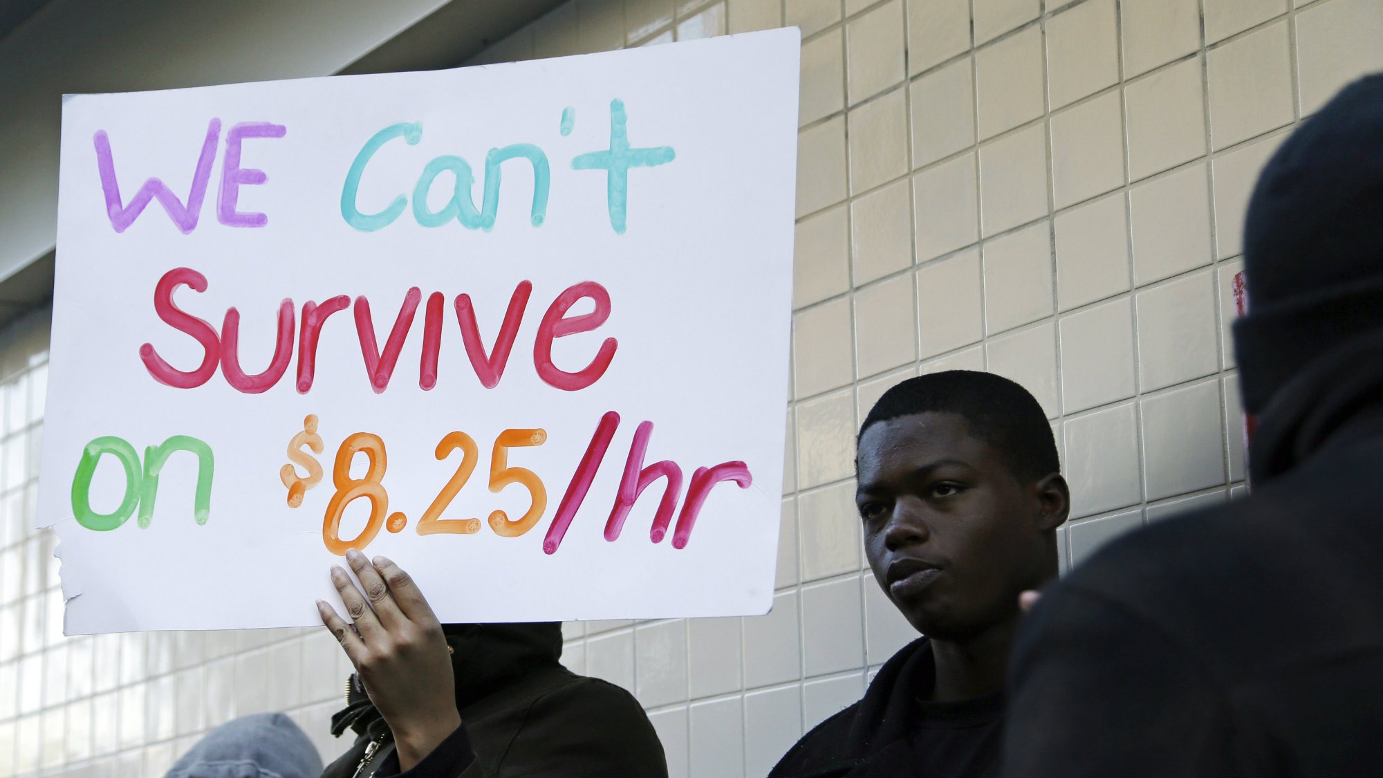 In this Thursday, Dec. 5, 2013, file photo, protestors demonstrate outside a McDonald's restaurant in Oakland, Calif.