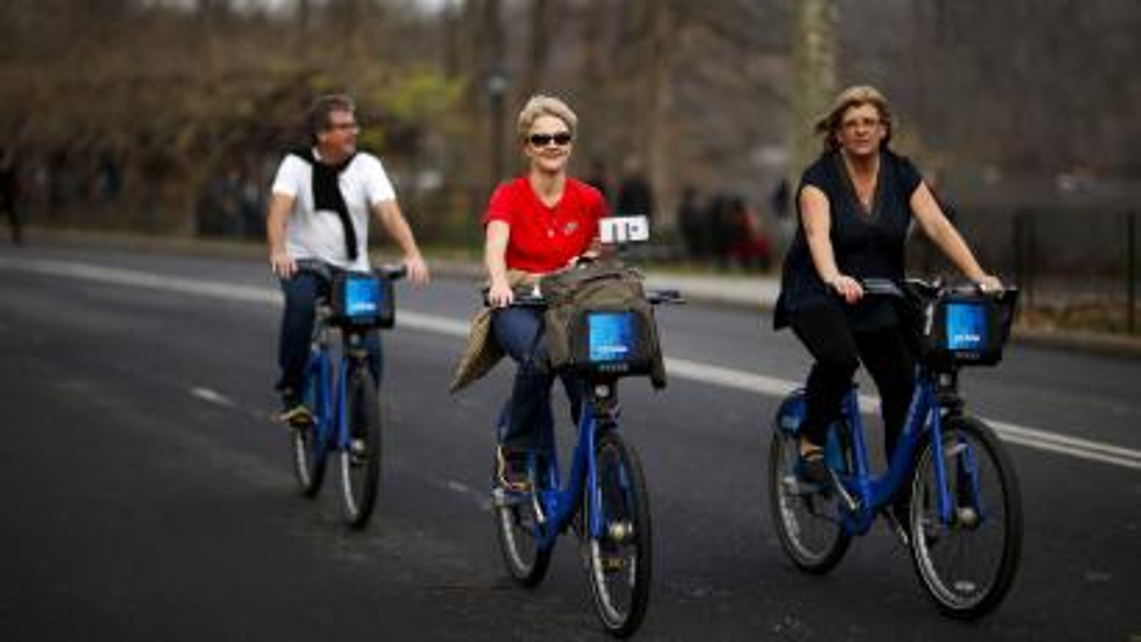 Women enjoy a warm day on their bikes in Central Park