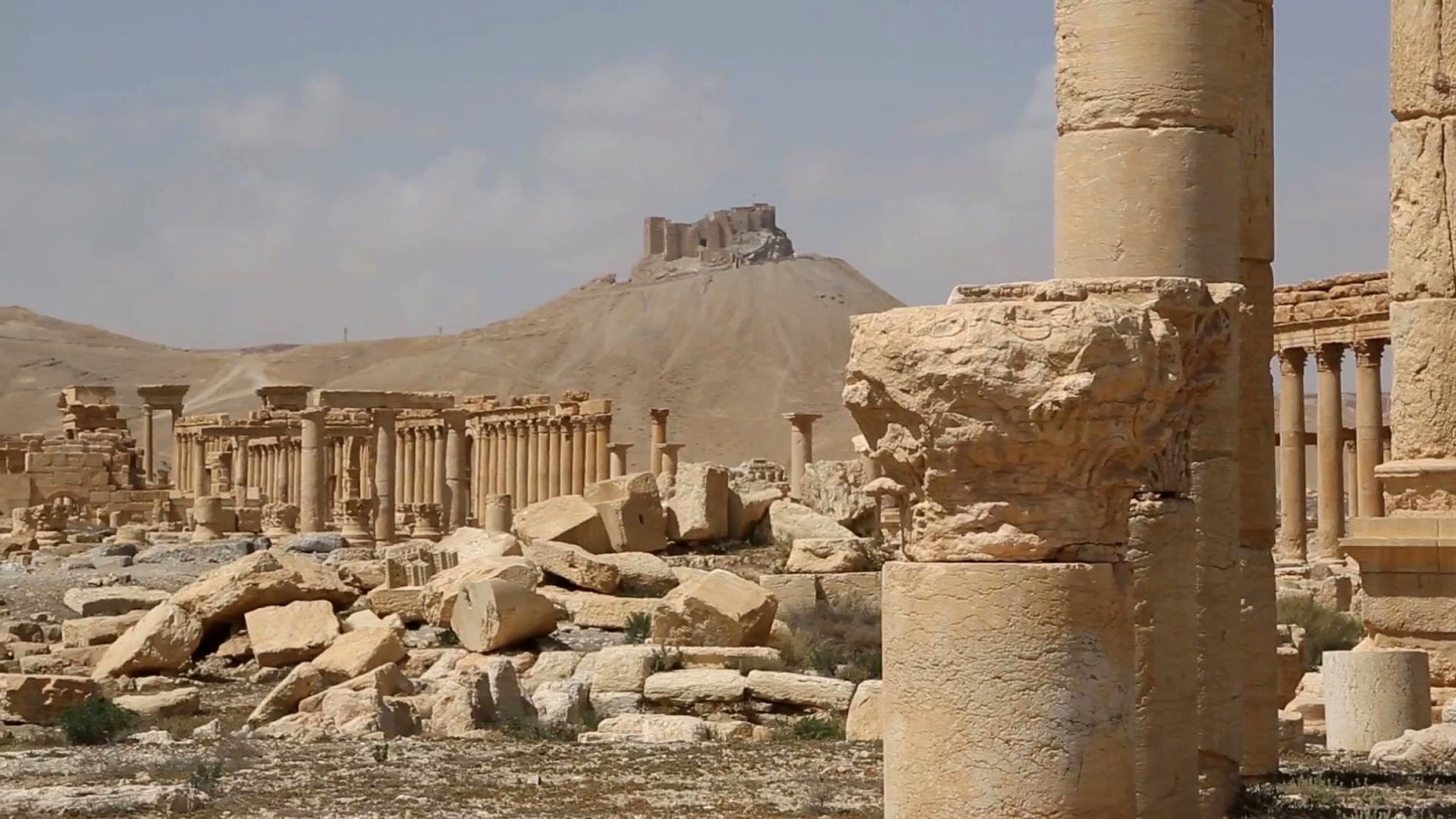 This photo released on Monday March 28, 2016, by the Syrian official news agency SANA, shows a general view of the ancient ruins of Palmyra, central Syria. A Syrian antiquities official says demining experts have so far removed 150 bombs planted by the Islamic State group inside the archaeological site in the historic town of Palmyra. Syrian troops captured the town from IS fighters on Sunday after three weeks of intense fighting. (SANA via AP)