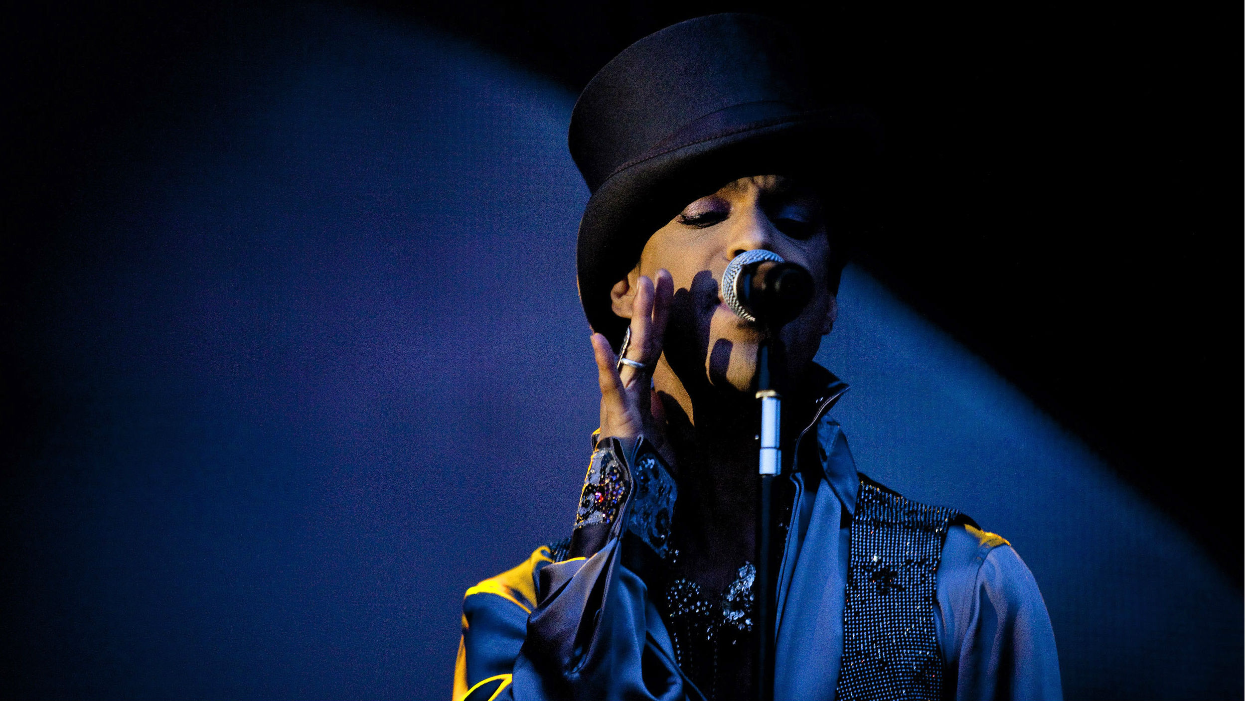 In this Saturday evening, Aug. 6 2011 photo American singer and songwriter Prince performs on the Isle of Amager in Copenhagen, Denmark. The concert was the first of two and it was interrupted by heavy rain.