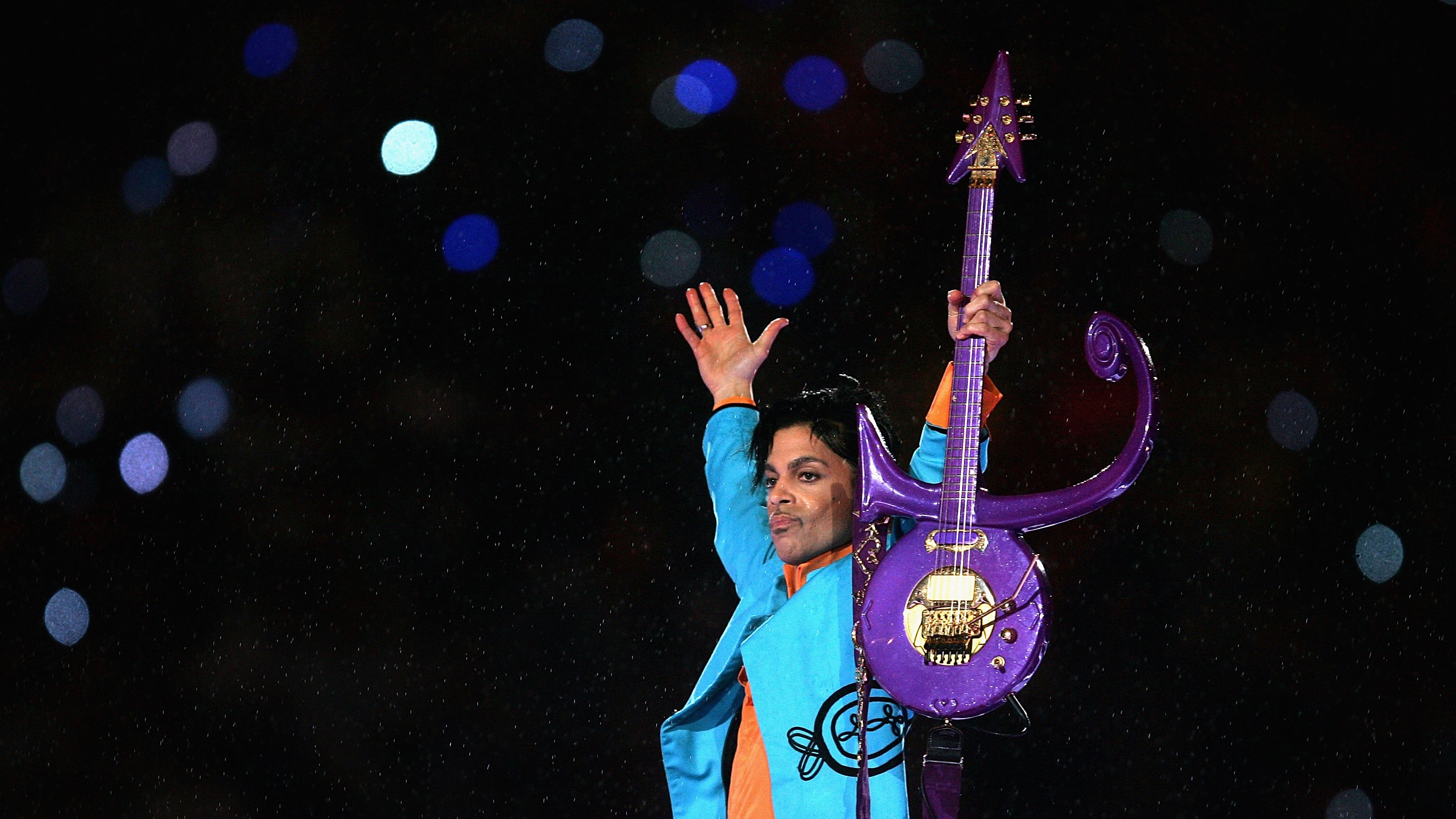 """Prince performs during the """"Pepsi Halftime Show"""" at Super Bowl XLI between the Indianapolis Colts and the Chicago Bears on February 4, 2007 at Dolphin Stadium in Miami Gardens, Florida."""