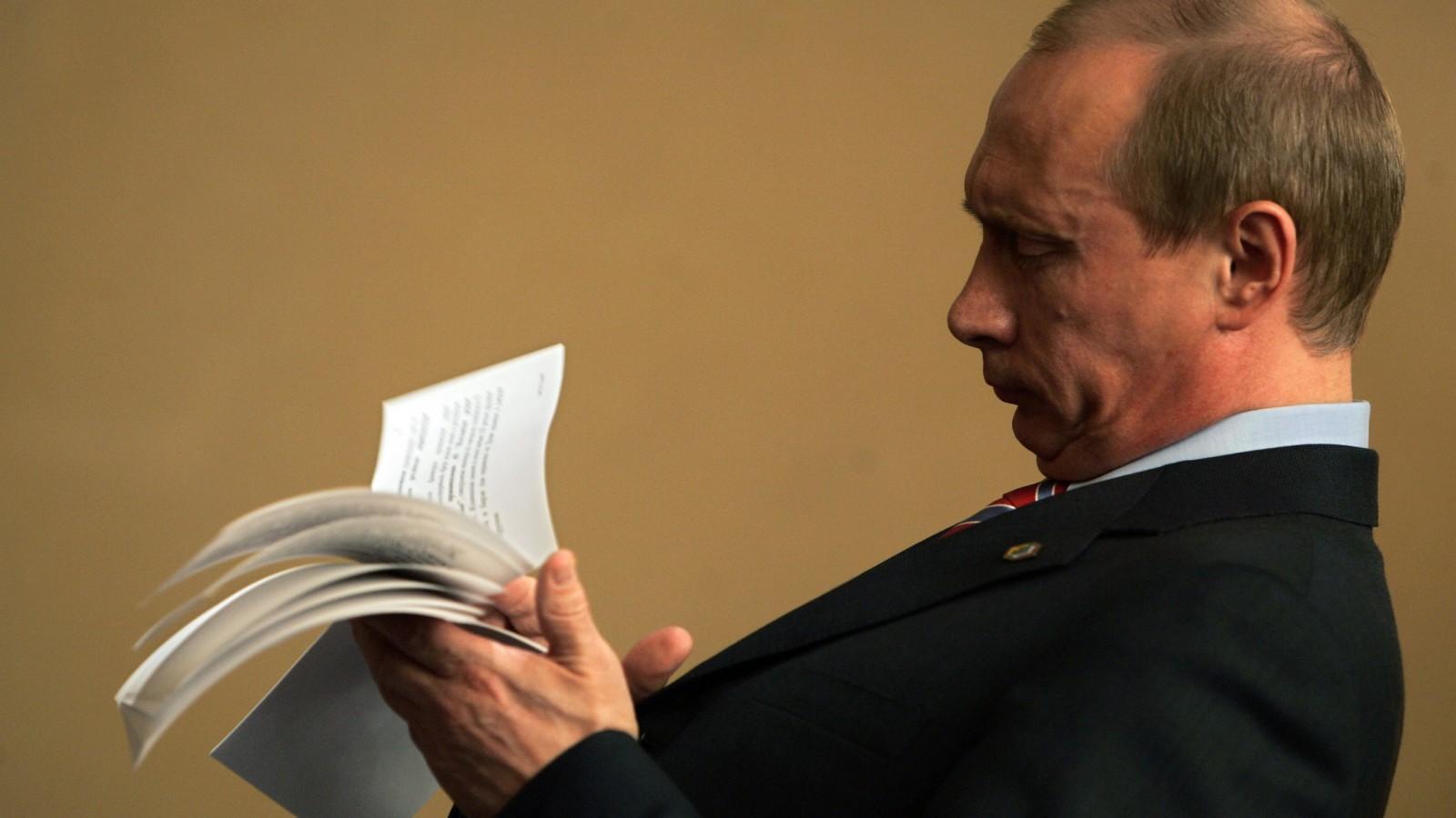 Russian President Vladimir Putin checks his notes.