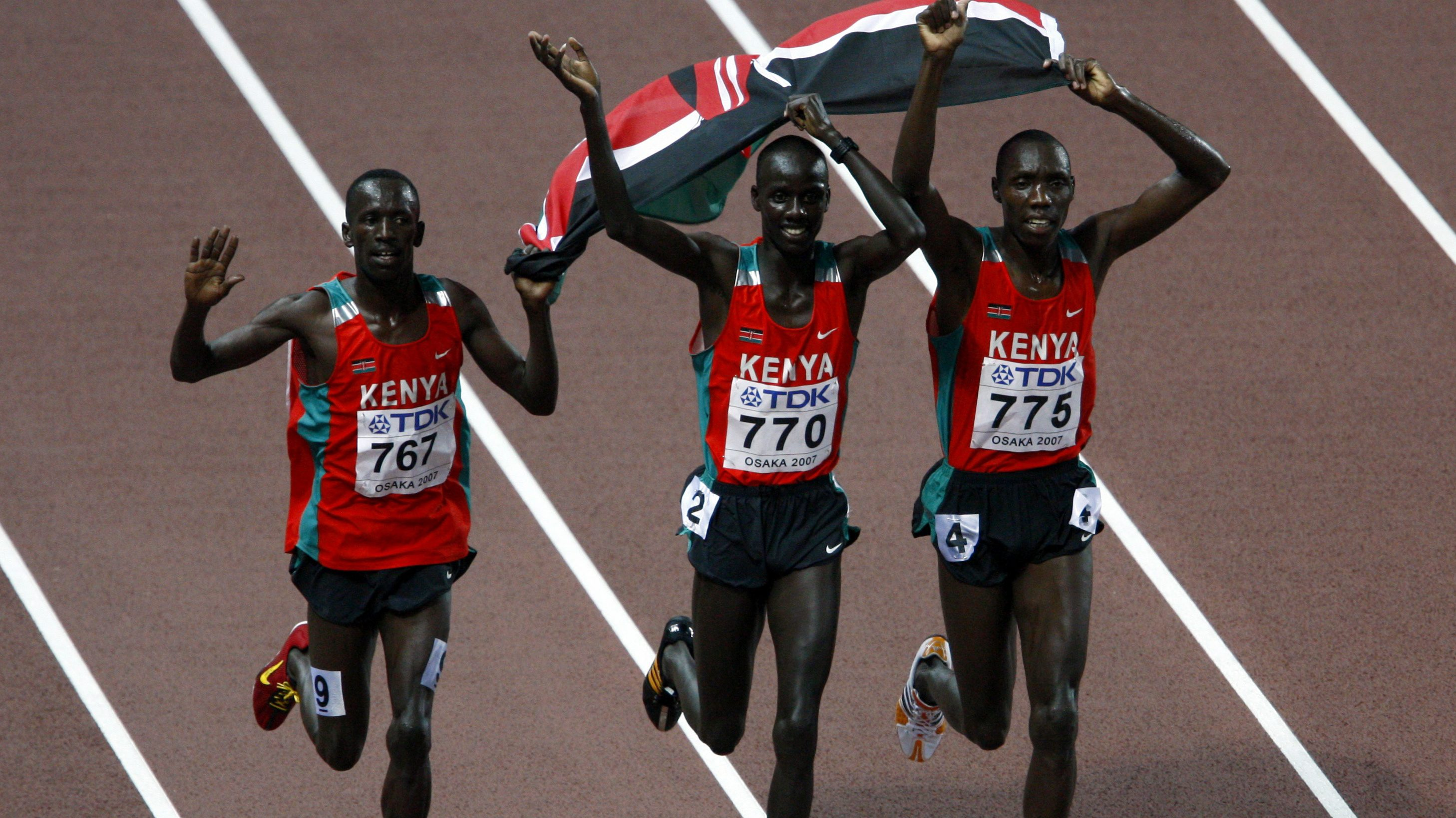 Kenya's Brimin Kiprop Kipruto (C), Richard Kipkemboi Mateelong (R) and Ezekiel Kemboi celebrate after the finals of the men's 3000 metres steeplechase during the 11th IAAF World Athletics Championship in Osaka August 28, 2007. REUTERS/Brian Snyder (JAPAN)   also see GF2E469187301 - RTR1T665