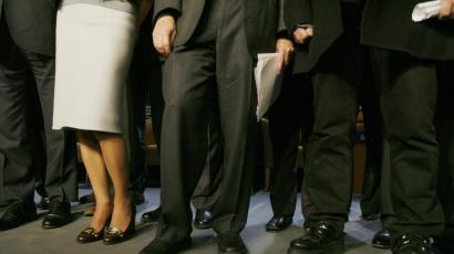 Shoes of Irish rock singer Bono (R) are seen as he stands next to Microsoft founder Bill Gates (C) and Jordan's Queen Rania to pose for photographers at the World Economic Forum (WEF) in Davos January 25, 2008.