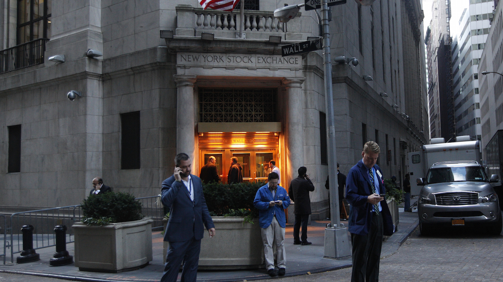 Traders stand outside the New York Stock Exchange prior to the opening bell October 31, 2012. Stock exchanges plan to open Wednesday after monster storm Sandy receded from New York, the New York Stock Exchange will renew normal operations at 9:30 a.m.