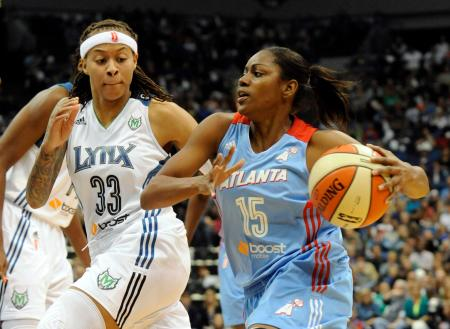Oct 6, 2013; Minneapolis, MN, USA; Atlanta Dream guard Tiffany Hayes (15) drives to the basket while defended by Minnesota Lynx guard Seimone Augustus (33) in the second quarter in game one of the WNBA Finals at Target Center.