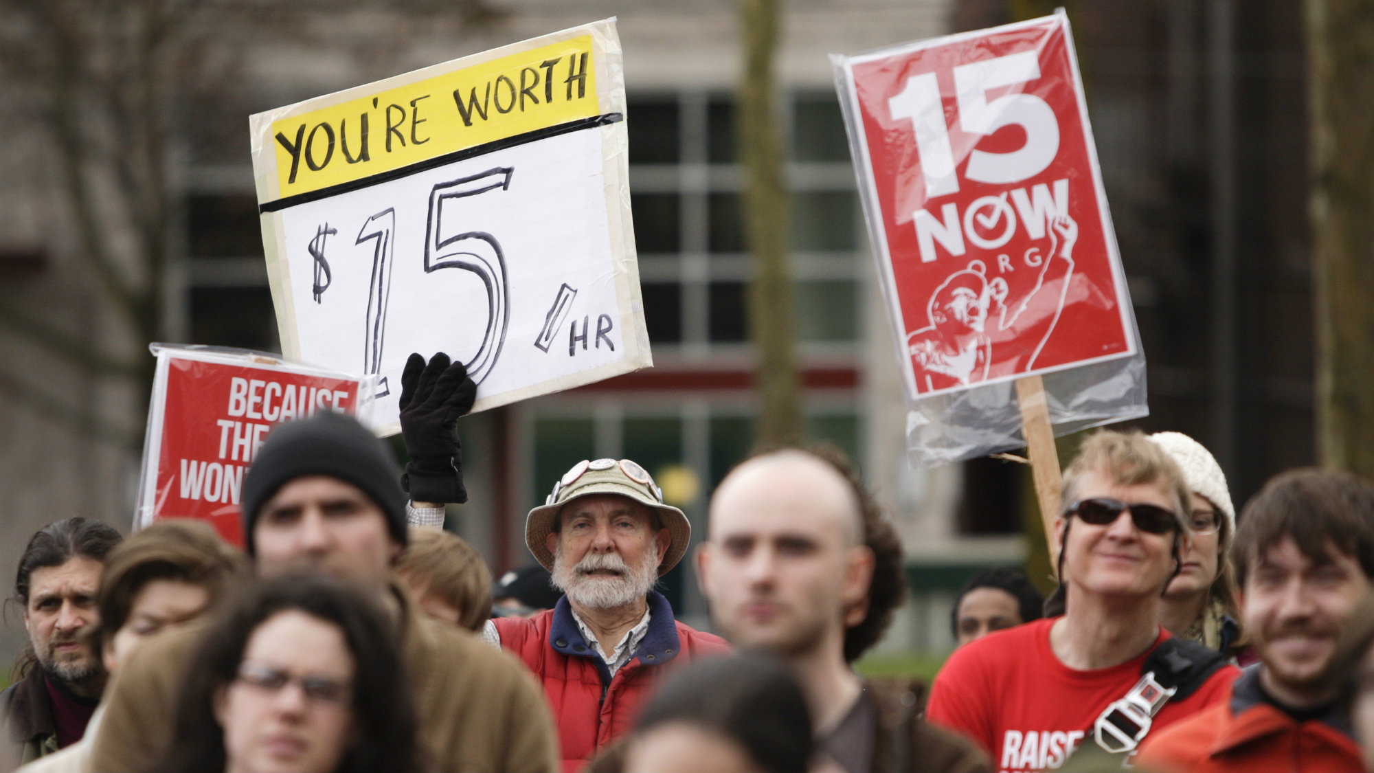 People rally in support of a $15 minimum wage at Seattle Central Community College in Seattle, Washington.