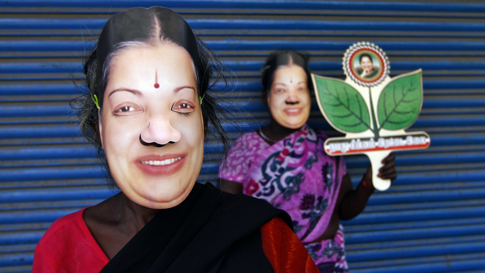 Supporters of J. Jayalalithaa, chief minister of India's Tamil Nadu state and chief of Anna Dravida Munetra Khazhgam (AIADMK), wear masks and hold her party's symbol during an election campaign ahead of the general elections in the southern Indian city of Chennai March 21, 2014. The politics of forming India's next government could come down to how many seats a 1960s matinee siren can wrest from a rival named Stalin in Tamil Nadu. Picture taken March 21, 2014.