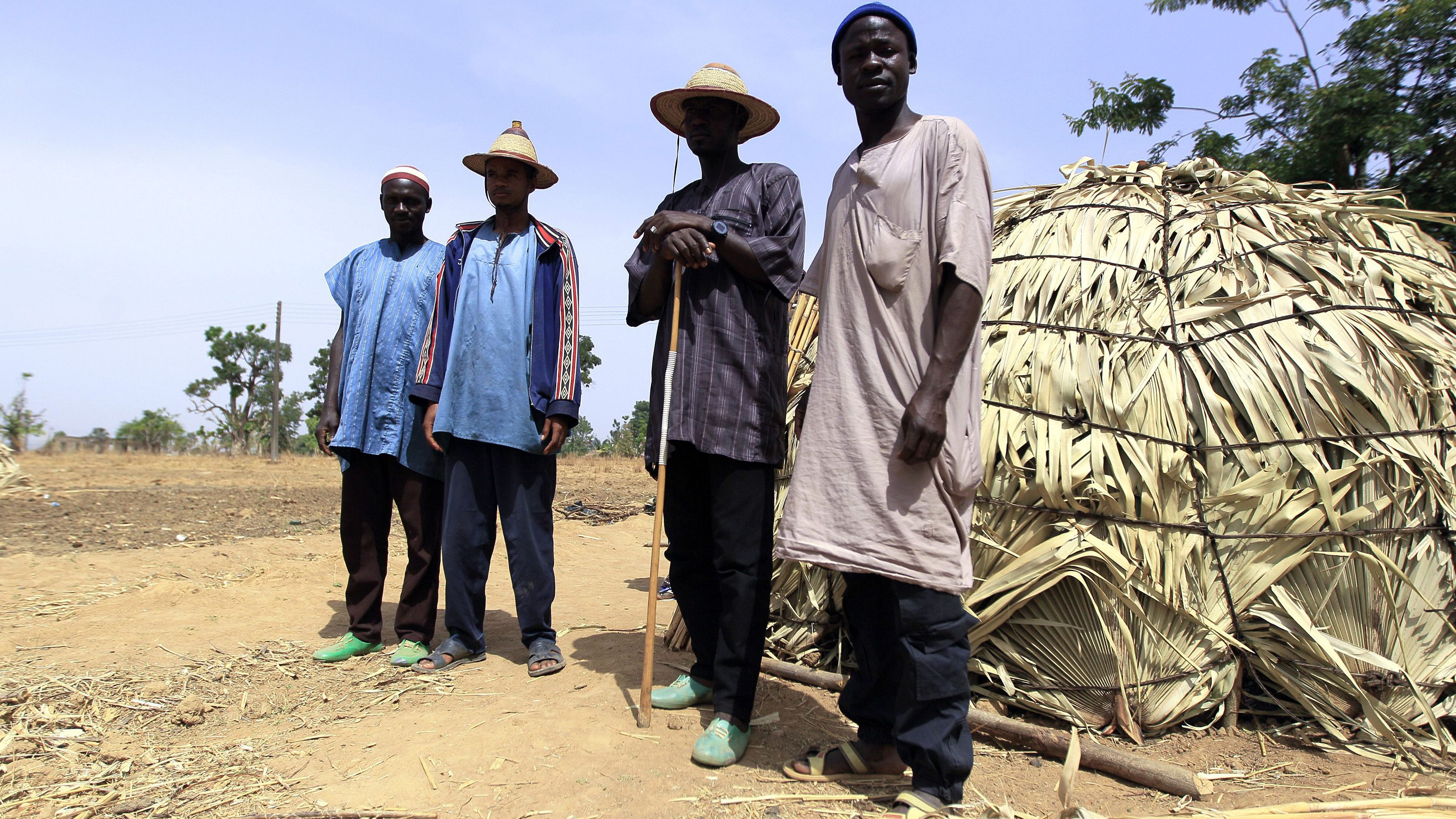 Fulani herdsman Musa Adamu (R) poses for a picture with other Fulani herdsman in Zango, Zango-kataf local govt, Kaduna State March 22, 2014. Picture taken March 22, 2014. To match Insight NIGERIA-UNITY/  REUTERS/Afolabi Sotunde (NIGERIA - Tags: CIVIL UNREST SOCIETY) - RTR3MV9Q