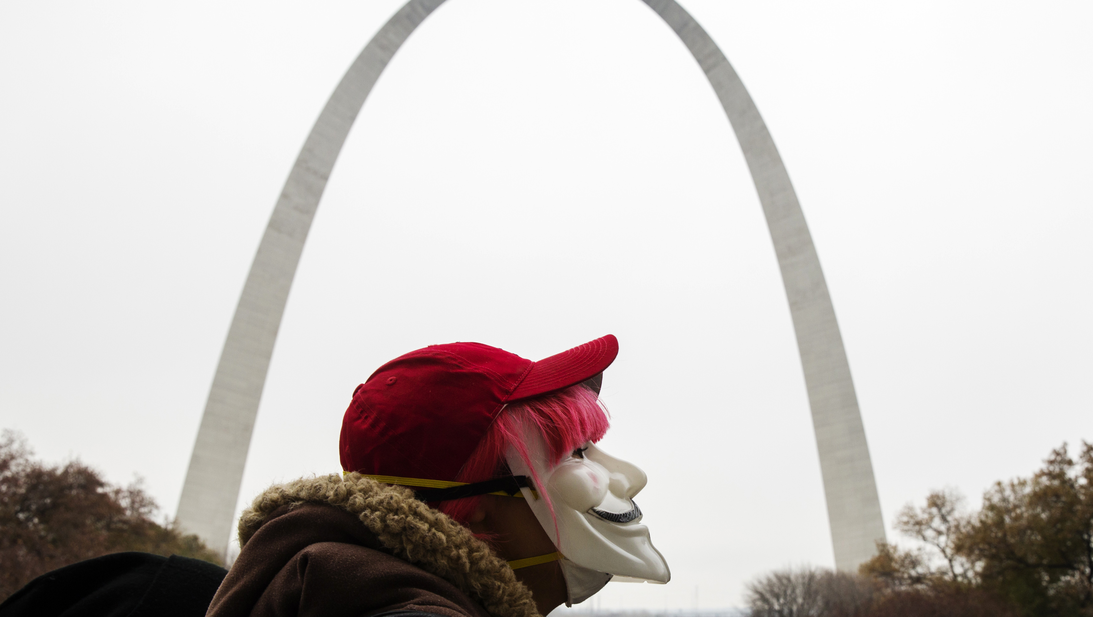 """A demonstrator takes part in a """"mock trial"""" of Darren Wilson as they protest a grand jury's decision not to indict Wilson for killing Michael Brown, in St. Louis"""