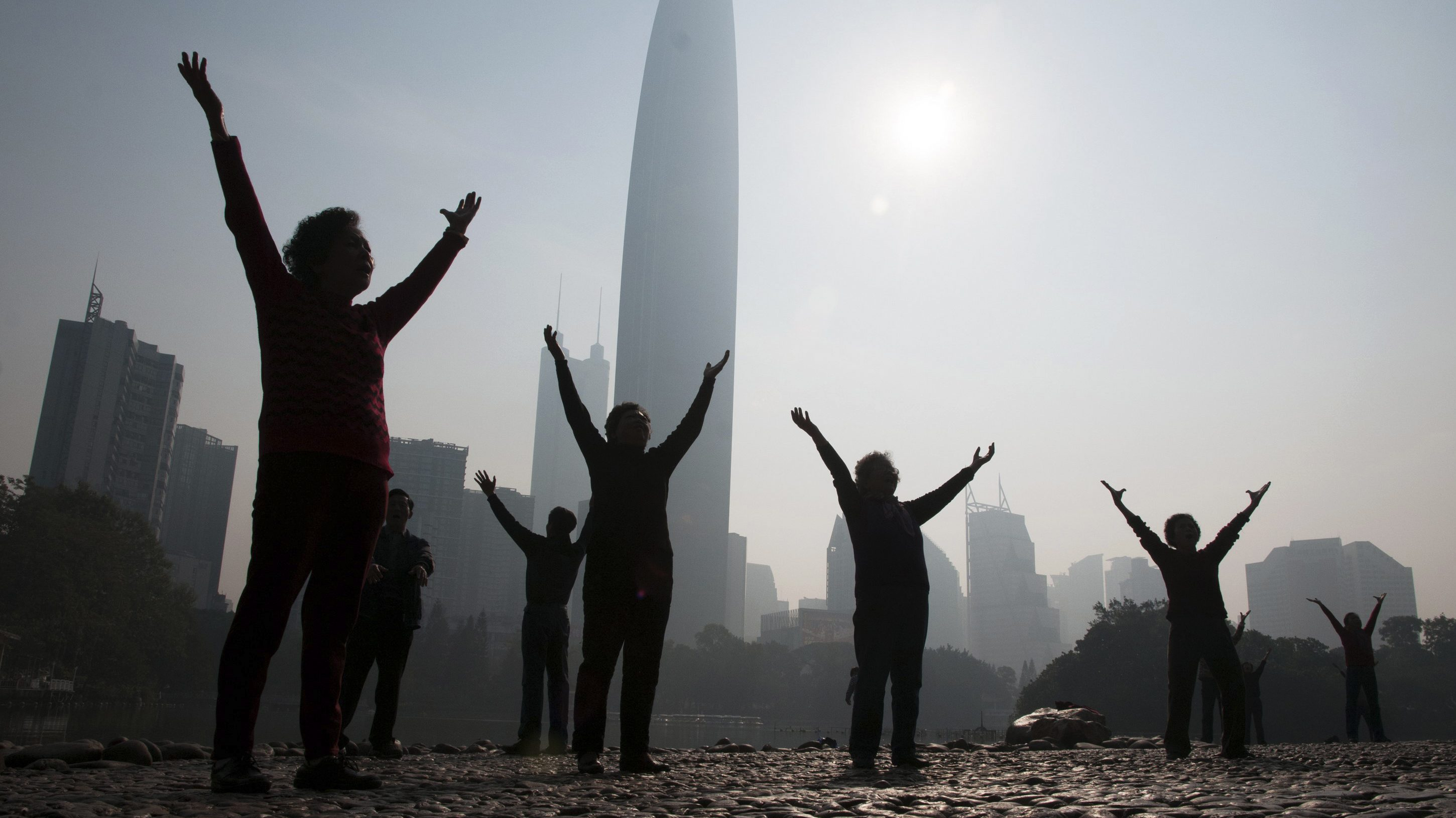 """Residents do morning exercises at a park on a hazy day in Shenzhen, Guangdong province February 12, 2015. Nearly 90 percent of China's big cities failed to meet air quality standards in 2014, but that was still an improvement on 2013 as the country's """"war on pollution"""" began to take effect, the environment ministry said on February 2. REUTERS/Stringer (CHINA - Tags: ENVIRONMENT SOCIETY) CHINA OUT. NO COMMERCIAL OR EDITORIAL SALES IN CHINA - RTR4P8T4"""