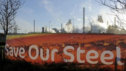 A sign is seen in front of the Tata steelworks in the town of Port Talbot, Wales, Britain March 30, 2016.