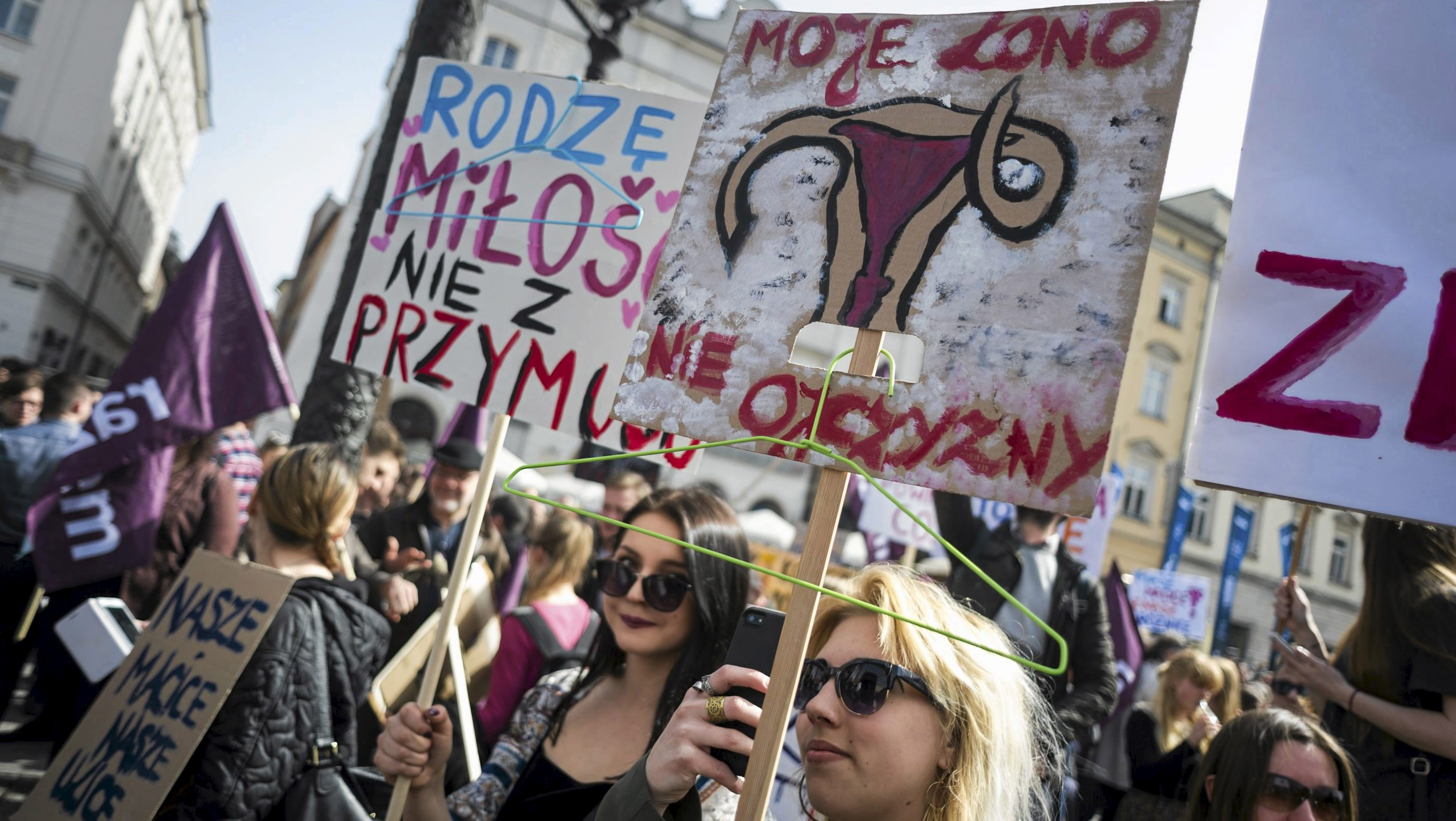 People demonstrate against the Polish government's plans of tightening the abortion law in Krakow, Poland