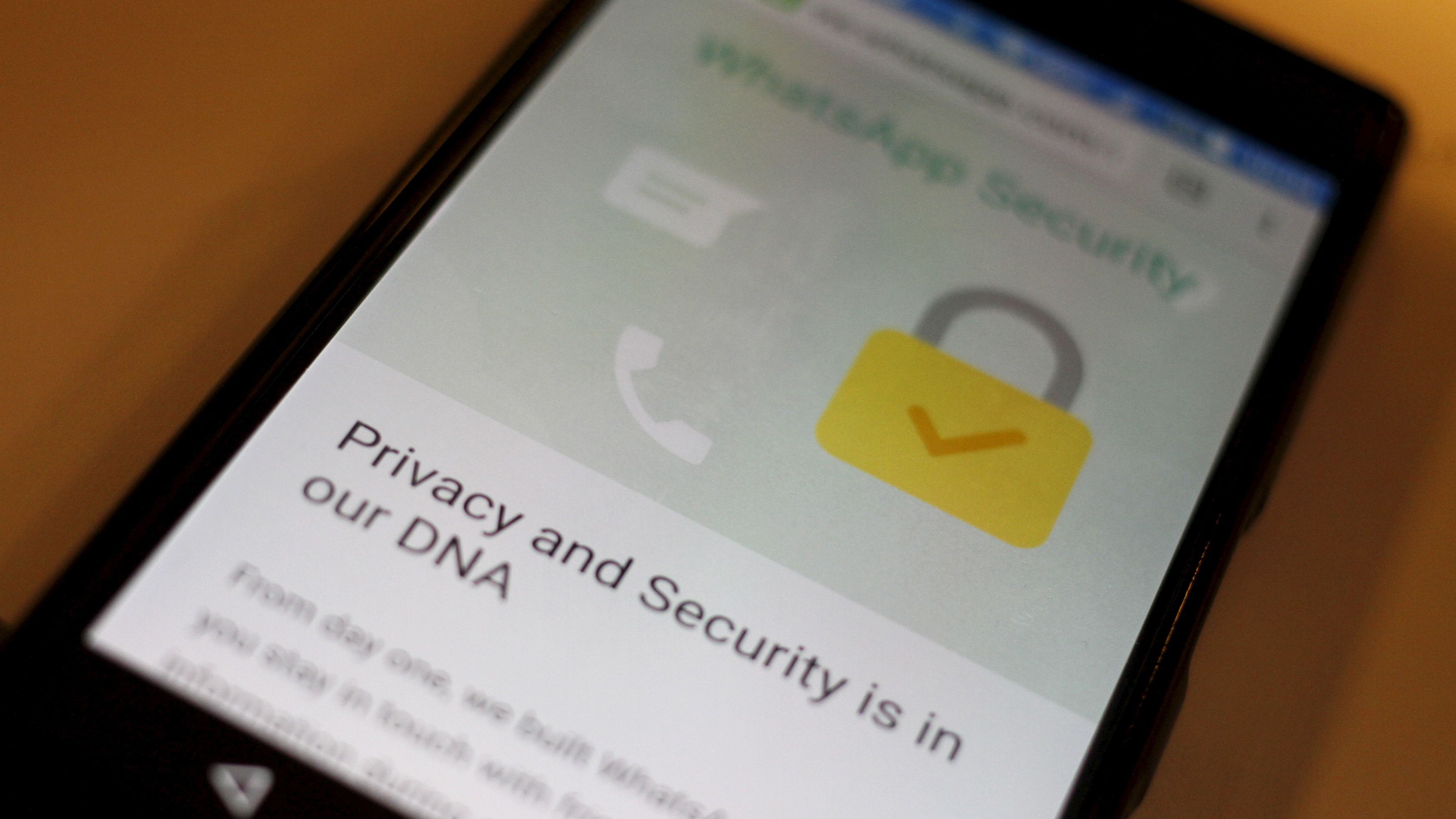 A security message is seen on a Whatsapp screen in this illustration photo April 6, 2016.   REUTERS/Thomas White/Illustration - RTSDRHF