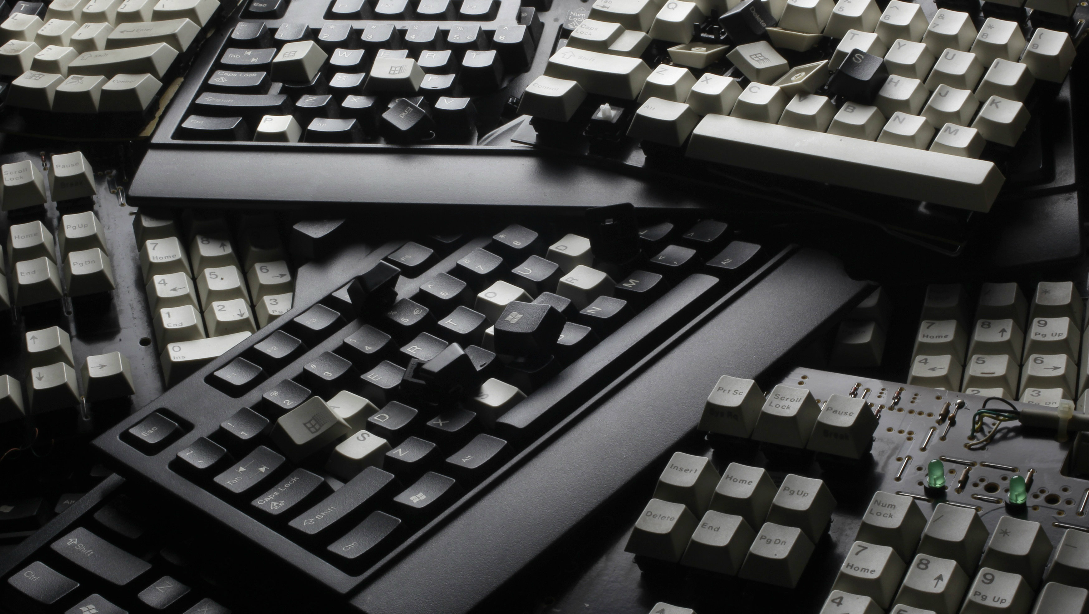 Broken computer keyboards are seen in this illustration picture taken in Warsaw, December 13, 2013.