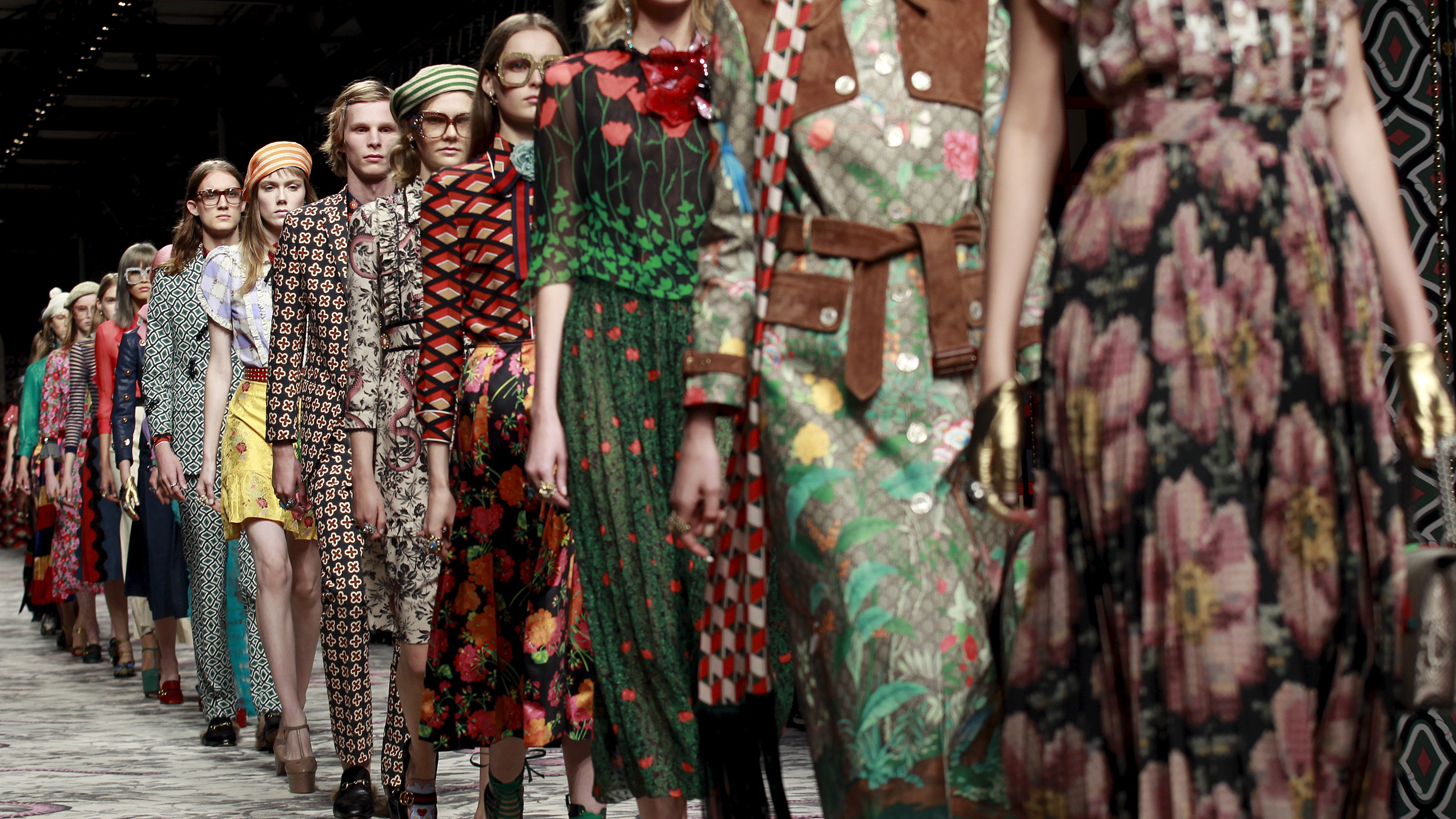Models parade at the end of Gucci's Spring/Summer 2016 collection during Milan Fashion Week in Italy September 23, 2015.