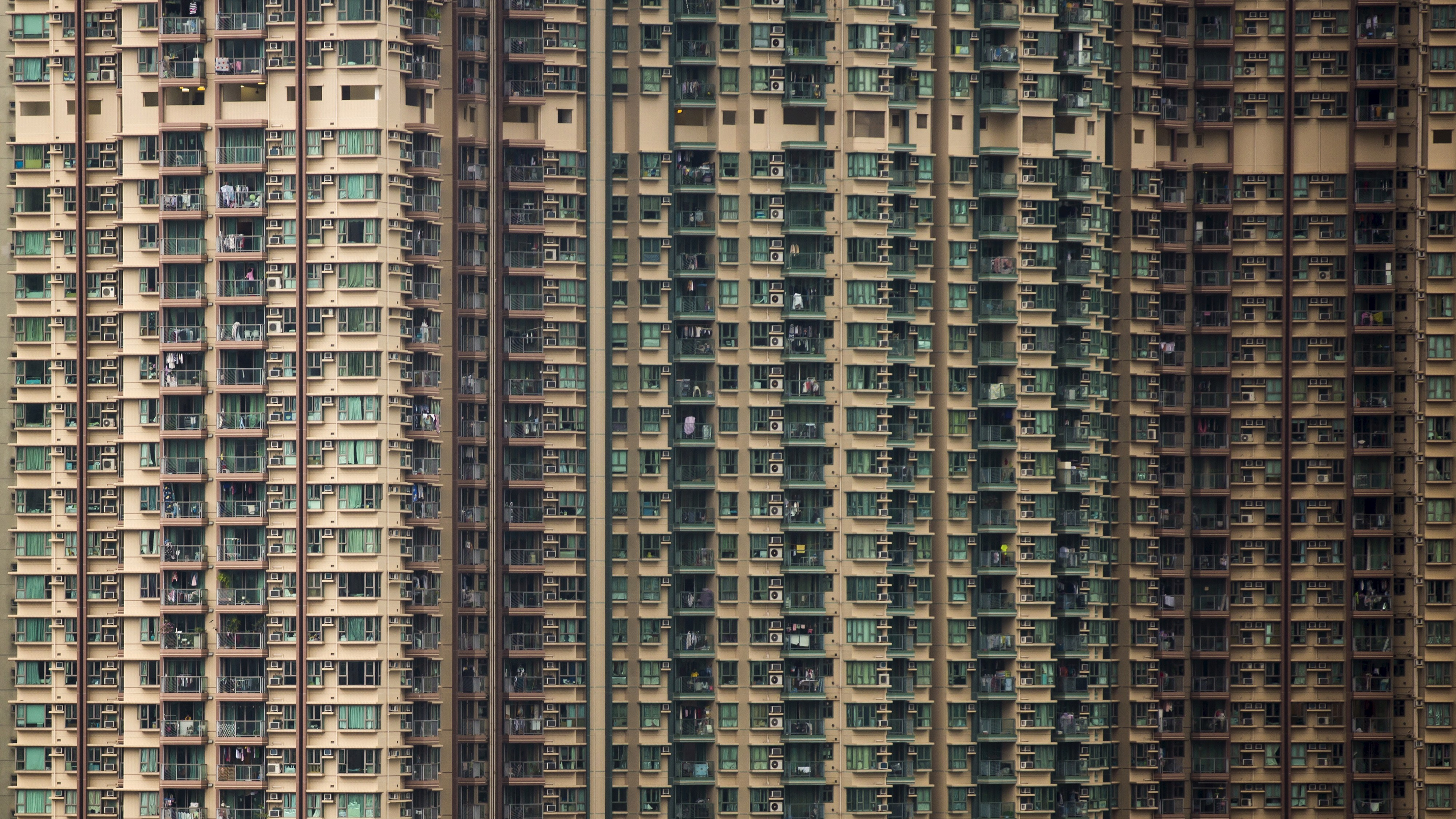 Private housing blocks are seen in Hong Kong, China December 15, 2015. Hong Kong is bracing for greater economic challenges as the prospect of a new cycle of interest rate rises drives fears of capital outflows that could put further pressure on the Asian financial hub. Hong Kong's property market, which has seen prices more than double since 2008, had already slowed in anticipation of a local rate hike, and analysts say a further slowdown will depend on China, which is facing its weakest growth in 25 years. Picture taken December 15. REUTERS/Tyrone Siu  - RTX1Z1I6